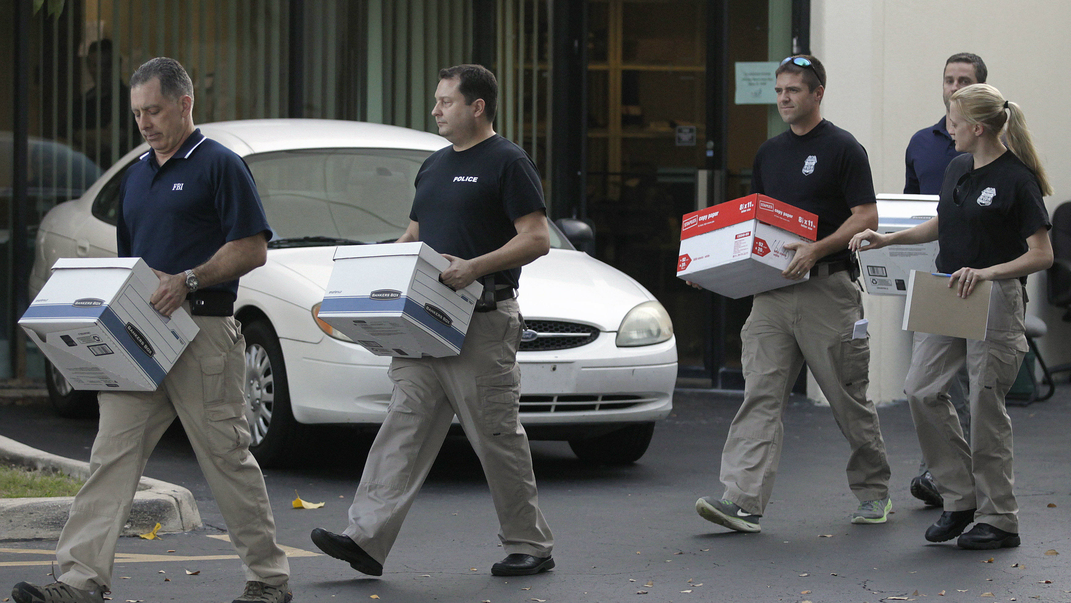 "Law enforcement officials remove boxes of material from the office of Med-Care Diabetic & Medical Supplies Inc. in Boca Raton, Florida January 14, 2015. U.S. FBI agents on Wednesday raided the offices of Med-Care Diabetic & Medical Supplies Inc, a Florida medical device company whose executive vice president Danny Porush helped inspire the movie ""The Wolf of Wall Street,"" according to a Reuters reporter and other witnesses."