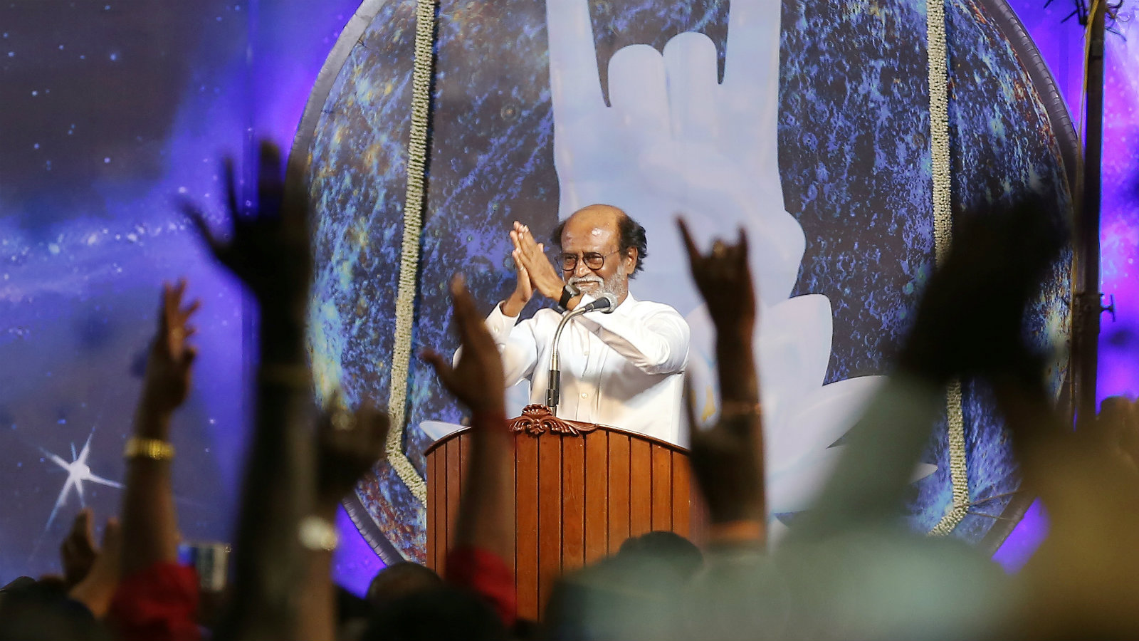 Rajinikanth greets his supporters after announcing the launch of his political party in Chennai, India, on Dec. 31, 2017.