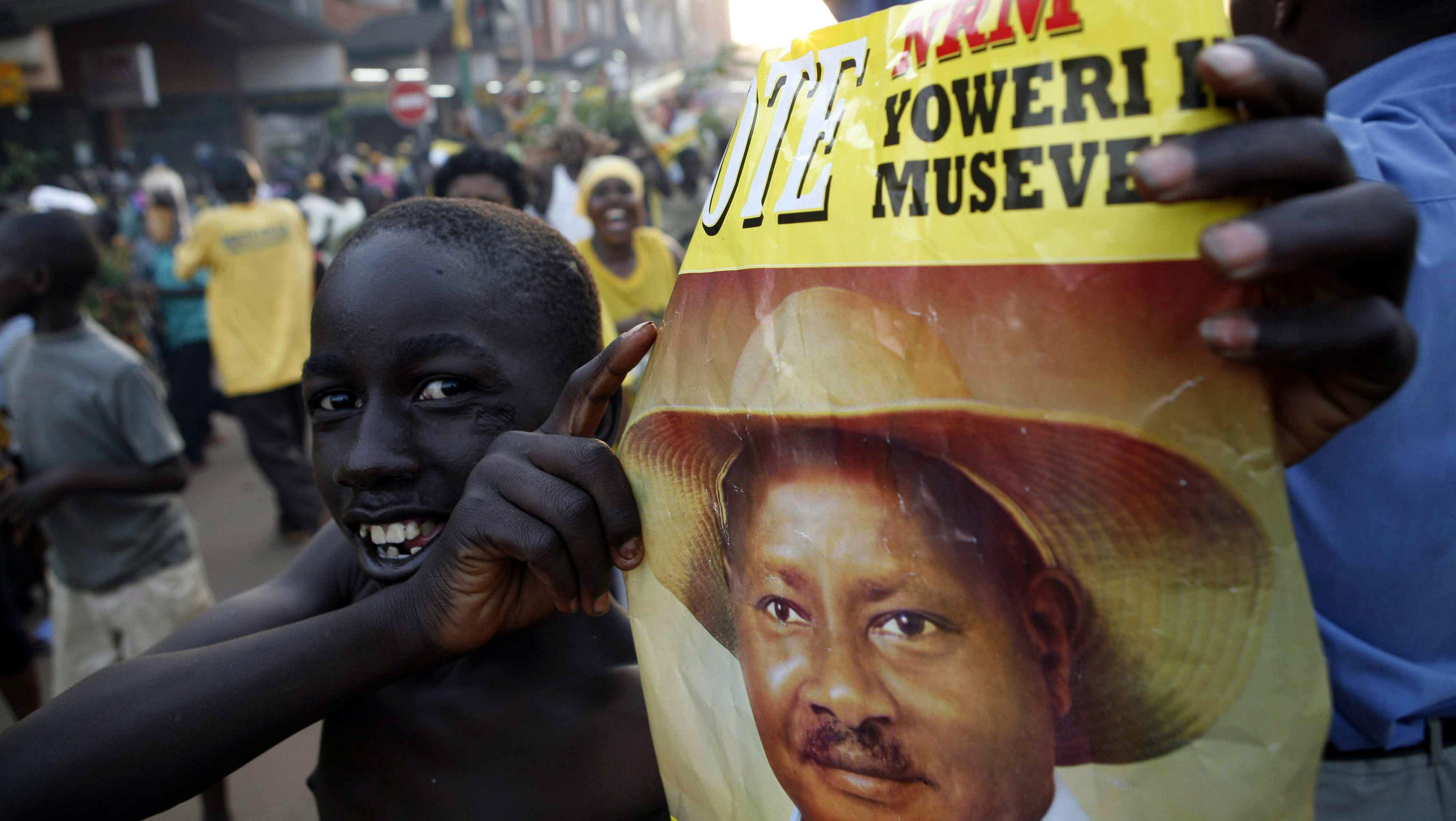 Supporter of Ugandan President Museveni celebrates in Kampala
