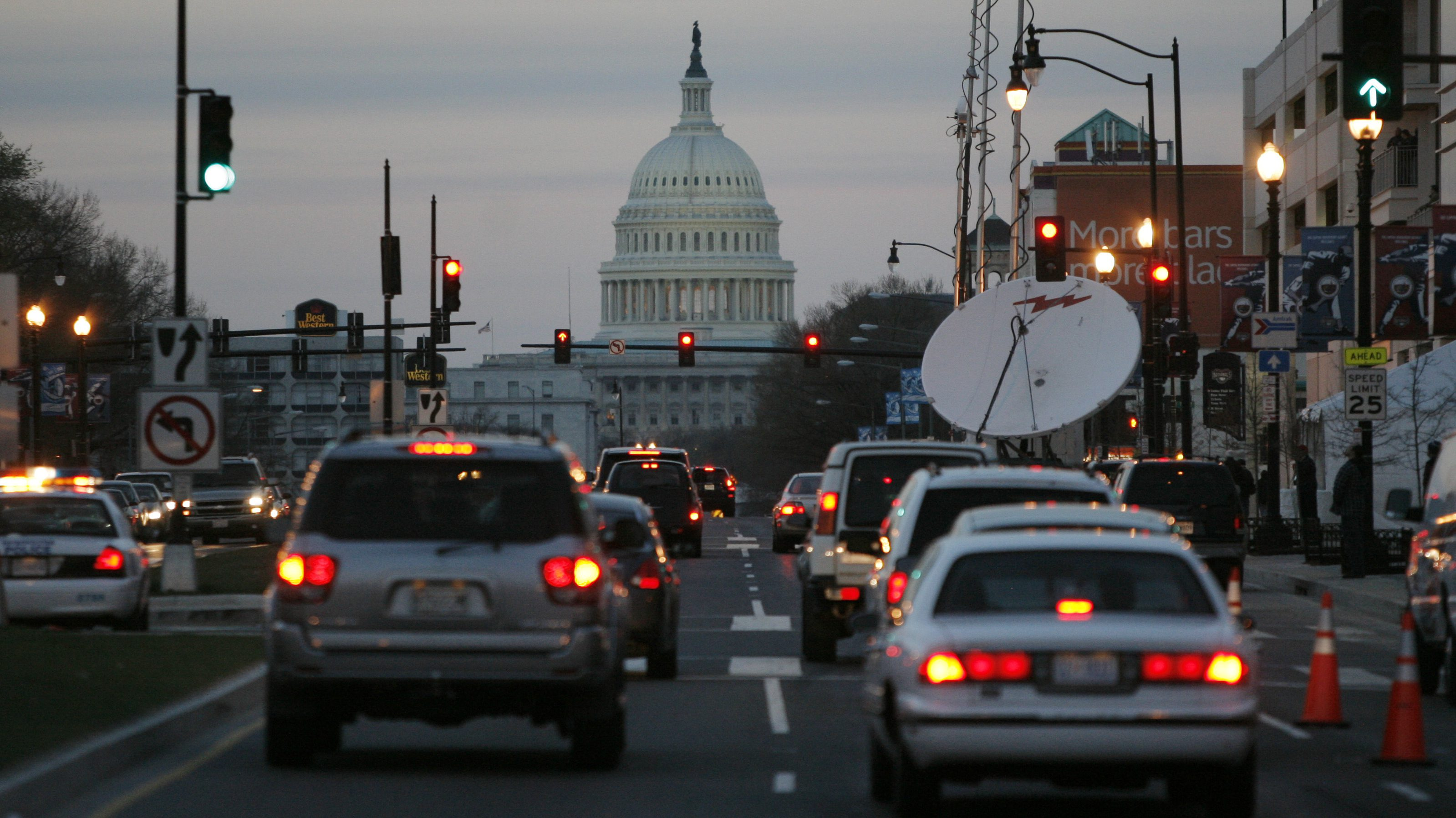 Traffic drives towards the U.S. Capitol building as they pass the outside of the new home of the Washington Nationals baseball team, Nationals Park, in Washington, March 29, 2008.