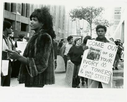 "A 1970 photo of Marsha P. Johnson handing out flyers in support of Gay Students at NYU is seen here courtesy of the New York Public Library's ""1969: The Year of Gay Liberation"" exhibit"