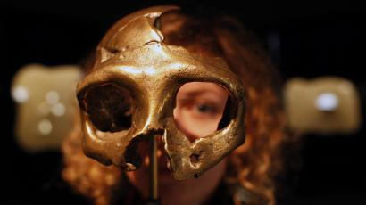 A girl looks through the replica of a neanderthal skull displayed in the new Neanderthal Museum in the northern town of Krapina February 25, 2010.