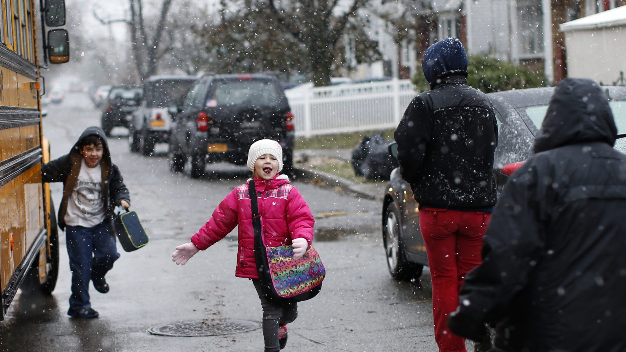 Children run to their parents after leaving the school bus in New Dorp section of the south shore of Staten Island, which was hard hit by Hurricane Sandy in New York City, November 7, 2012. A potent Nor'easter, or Northeaster storm, descended on the area Wednesday where many low lying shore areas including Midland Beach were under evacuation orders as the storm packing high winds rain and snow approached the New York area just over a week after Hurricane Sandy.  REUTERS/Mike Segar   (UNITED STATES - Tags: DISASTER ENVIRONMENT) - GM1E8B80I4801
