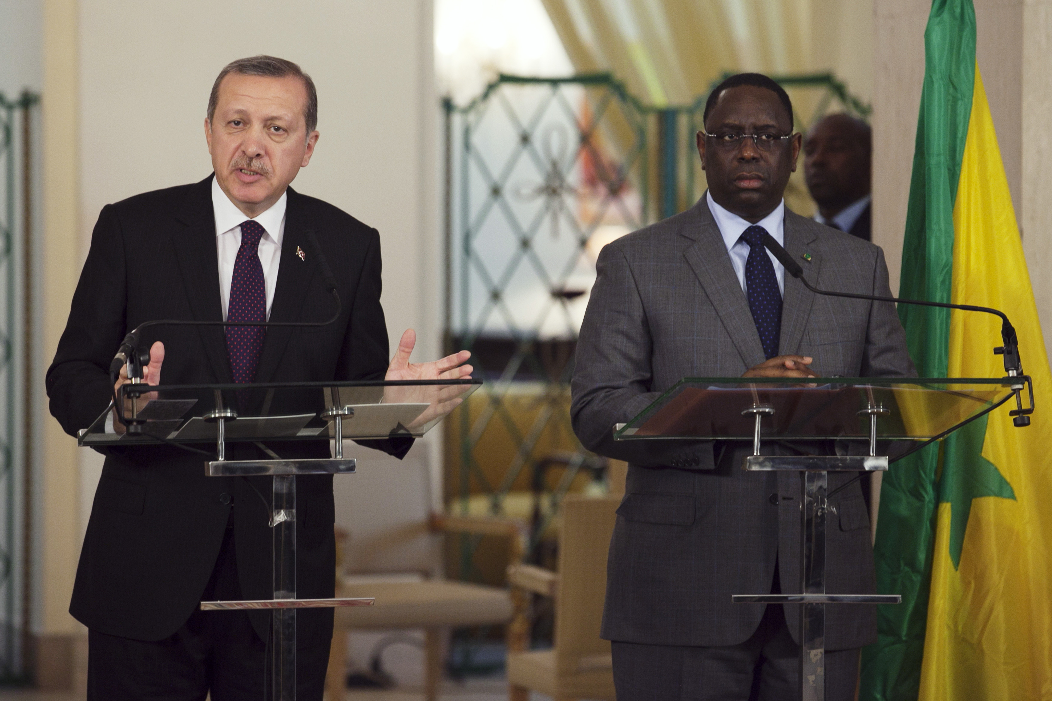 Turkey's Prime Minister Tayyip Erdogan (L) speaks to the media as Senegal's President Macky Sall looks on during a meeting between the two heads of state at the presidential palace in Dakar January 10, 2013.