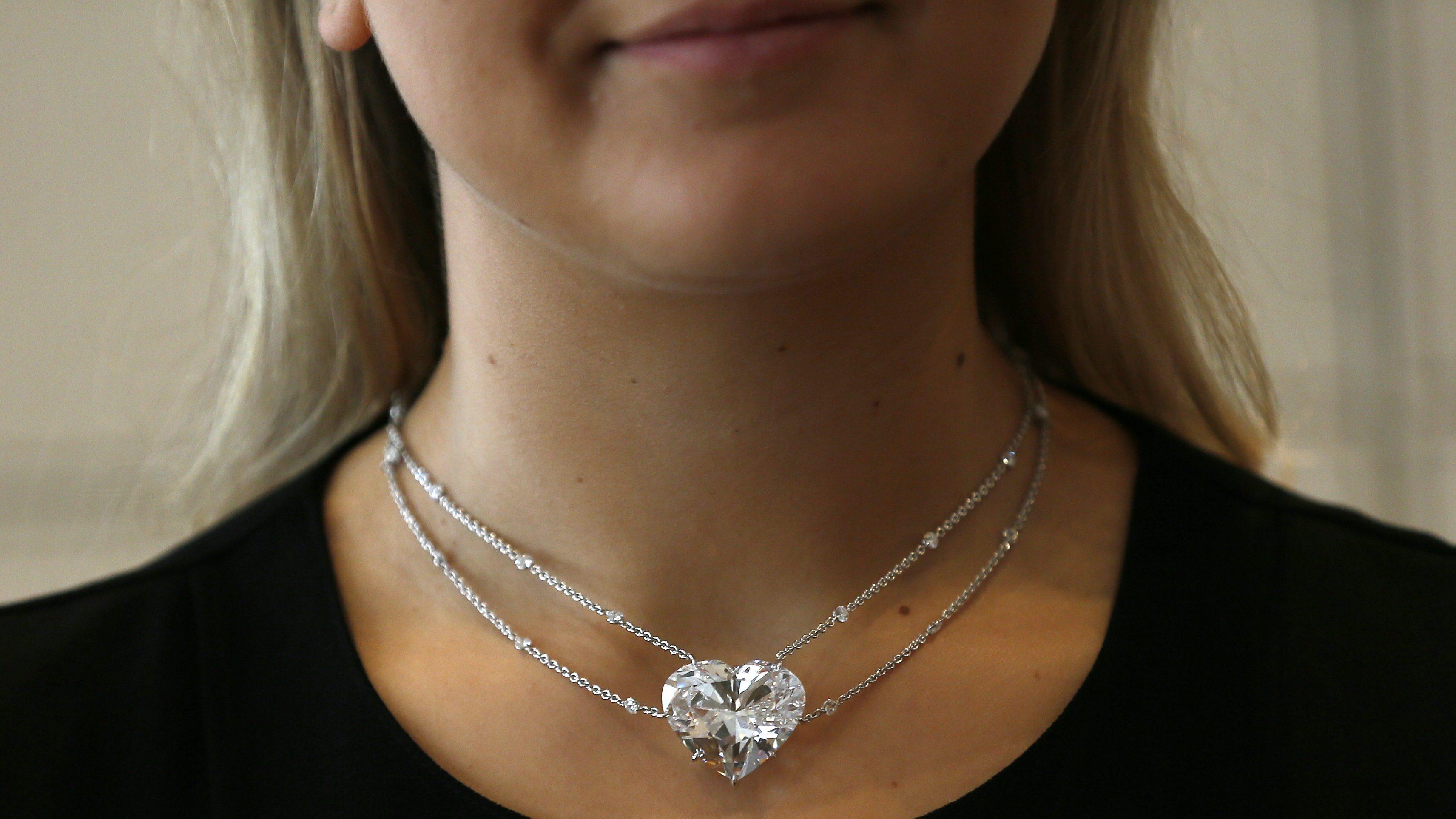 A model wears a 50.05-carat heart-shaped D-Colour internally flawless diamond pendan
