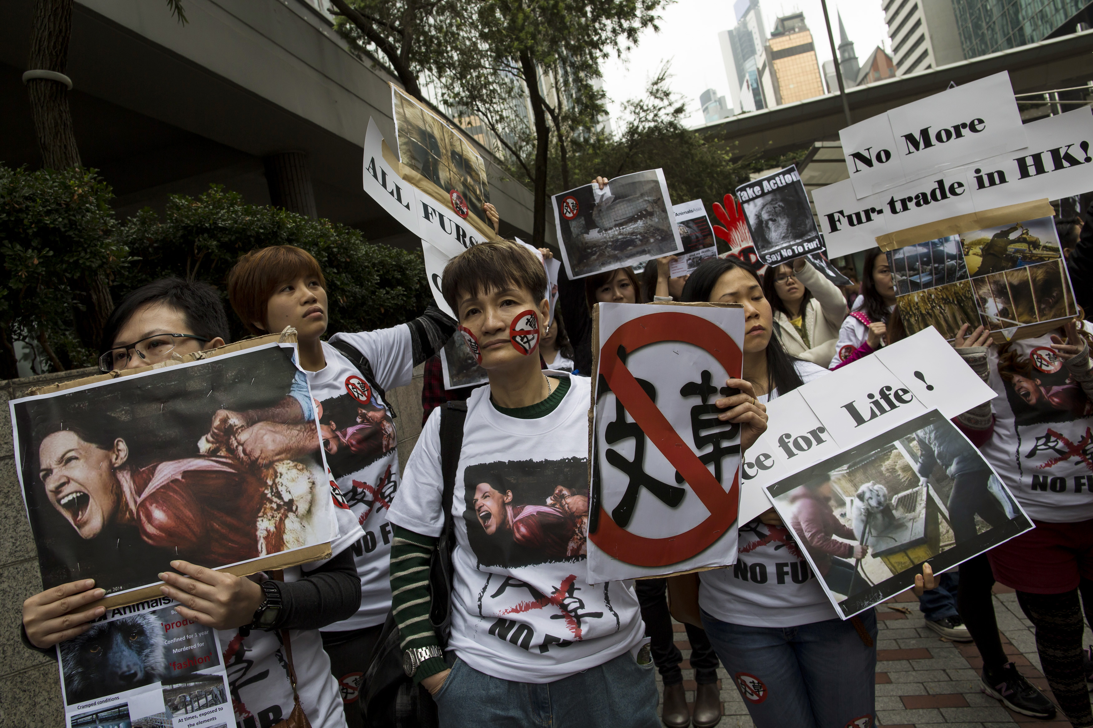 Members of animal rights groups march during a protest against the fur industry, outside the venue for Hong Kong International Fur and Fashion Fair in Hong Kong February 28, 2015. The annual Hong Kong International Fur and Fashion Fair is the world's largest fur fashion event, which brought $232 million (HK$1.8 billion) in exports in 2014, with 75 per cent of the world's fur and fur garments re-exported through the city, according to the Hong Kong Fur Federation. REUTERS/Tyrone Siu (CHINA - Tags: ANIMALS BUSINESS ENVIRONMENT FASHION CIVIL UNREST) - GM1EB2S1FFR01