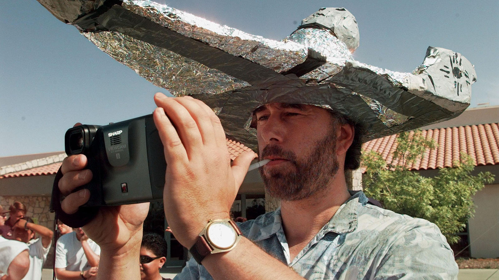 UFO FAN WEARS A TIN FOIL HAT AT ROSWELL UFO CONVENTION