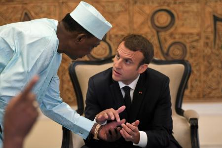 Chad's president Idriss Deby Itno speaks with French President Emmanuel Macron during a private meeting during a G5 Sahel summit, in Bamako, Mali.