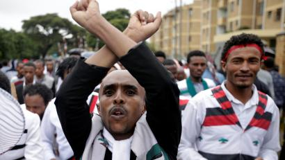 A demonstrator chants slogans while flashing the Oromo protest gesture during celebrations for Irreecha, the thanksgiving festival of the Oromo people, in Bishoftu town, Oromia region, Ethiopia, October 1, 2017.