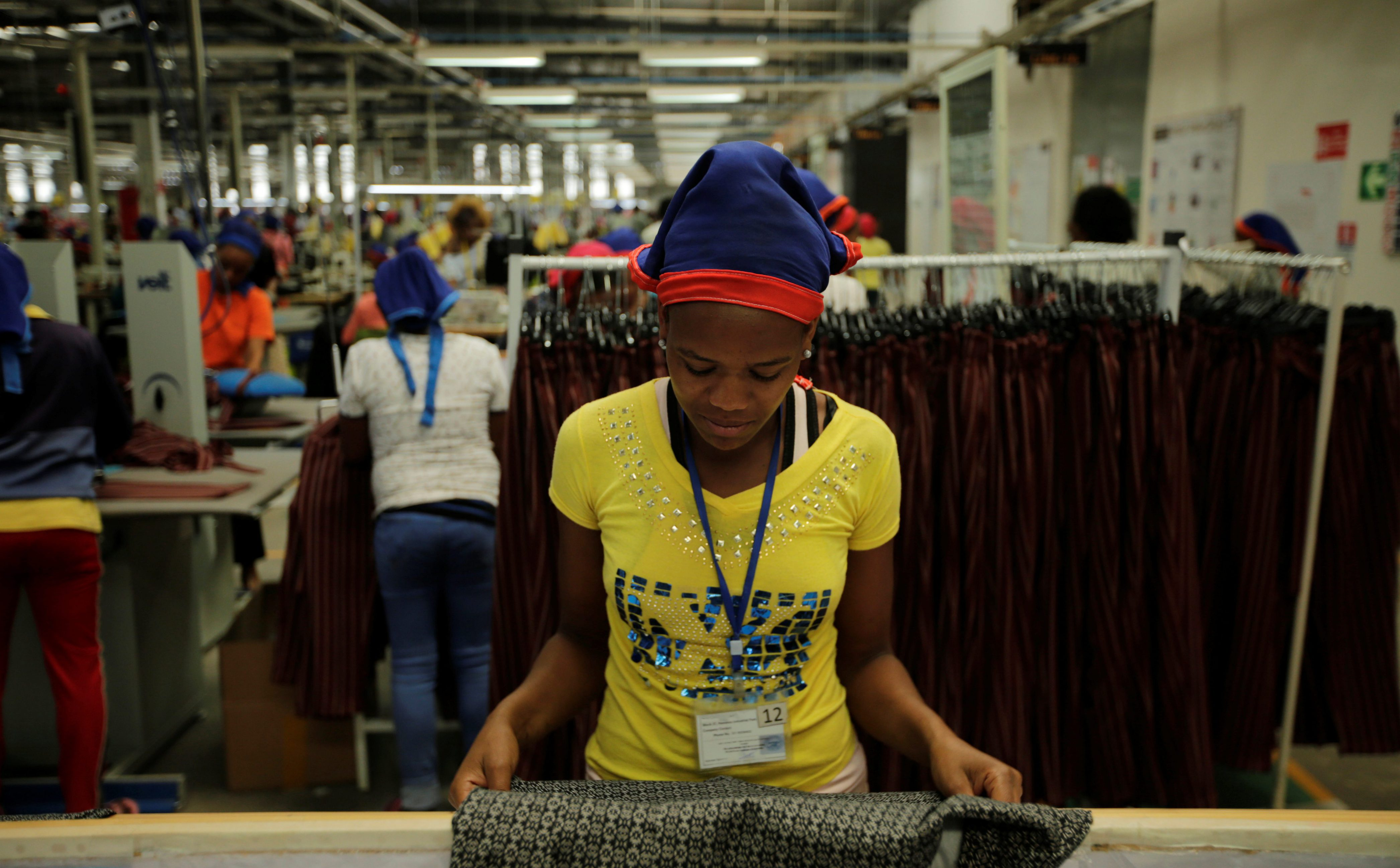 A worker sorts finished clothes inside the Indochine Apparel PLC textile factory in Hawassa Industrial Park in Southern Nations, Nationalities and Peoples region, Ethiopia November 17, 2017.