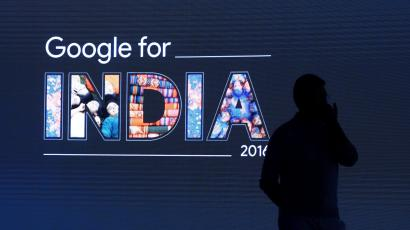 Man stands in front of a screen during a Google event in New Delhi