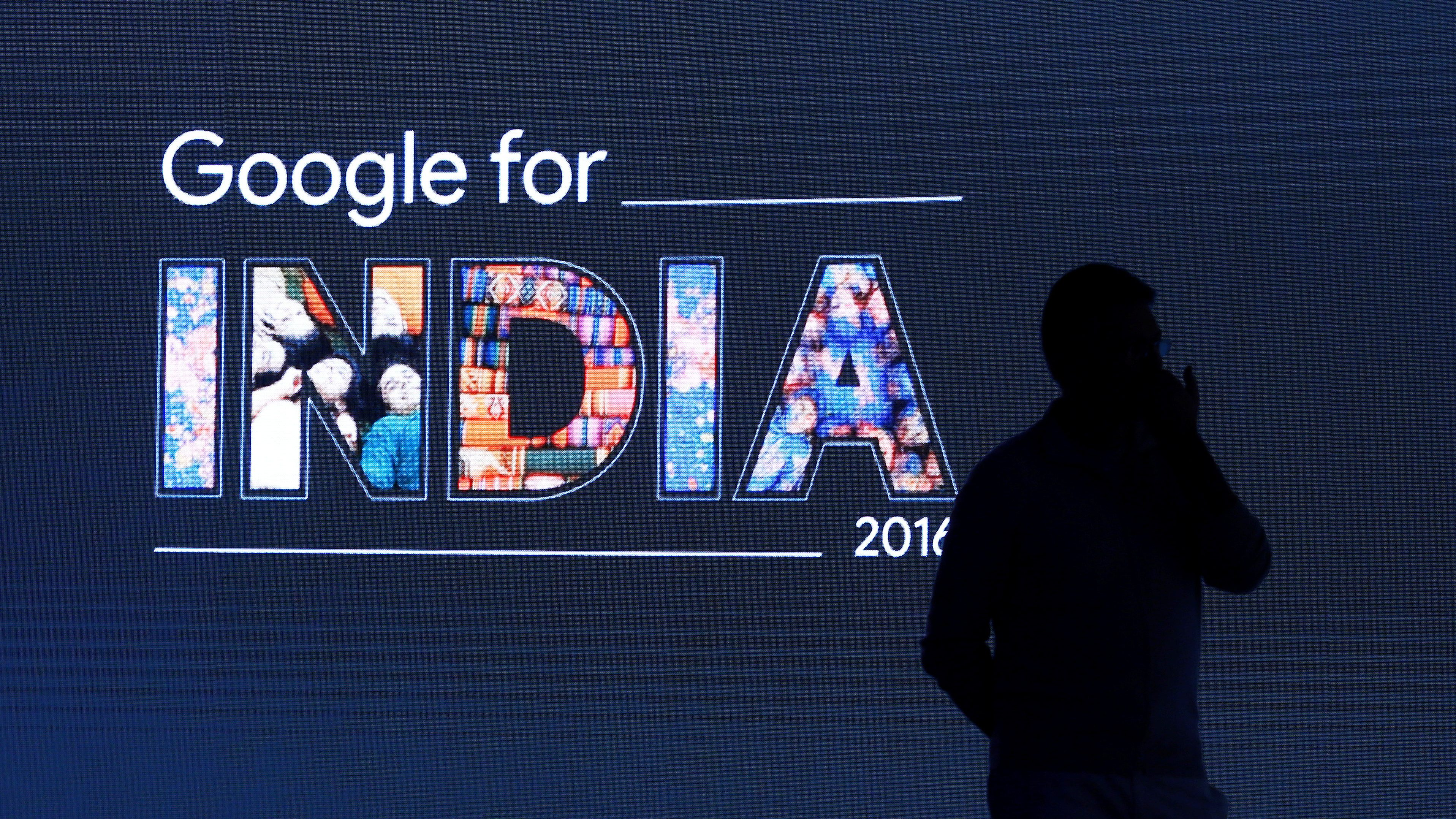 A  man stands in front of a screen during a Google event in New Delhi, India September 27, 2016. REUTERS/Adnan Abidi     TPX IMAGES OF THE DAY      - D1BEUDRMNNAA