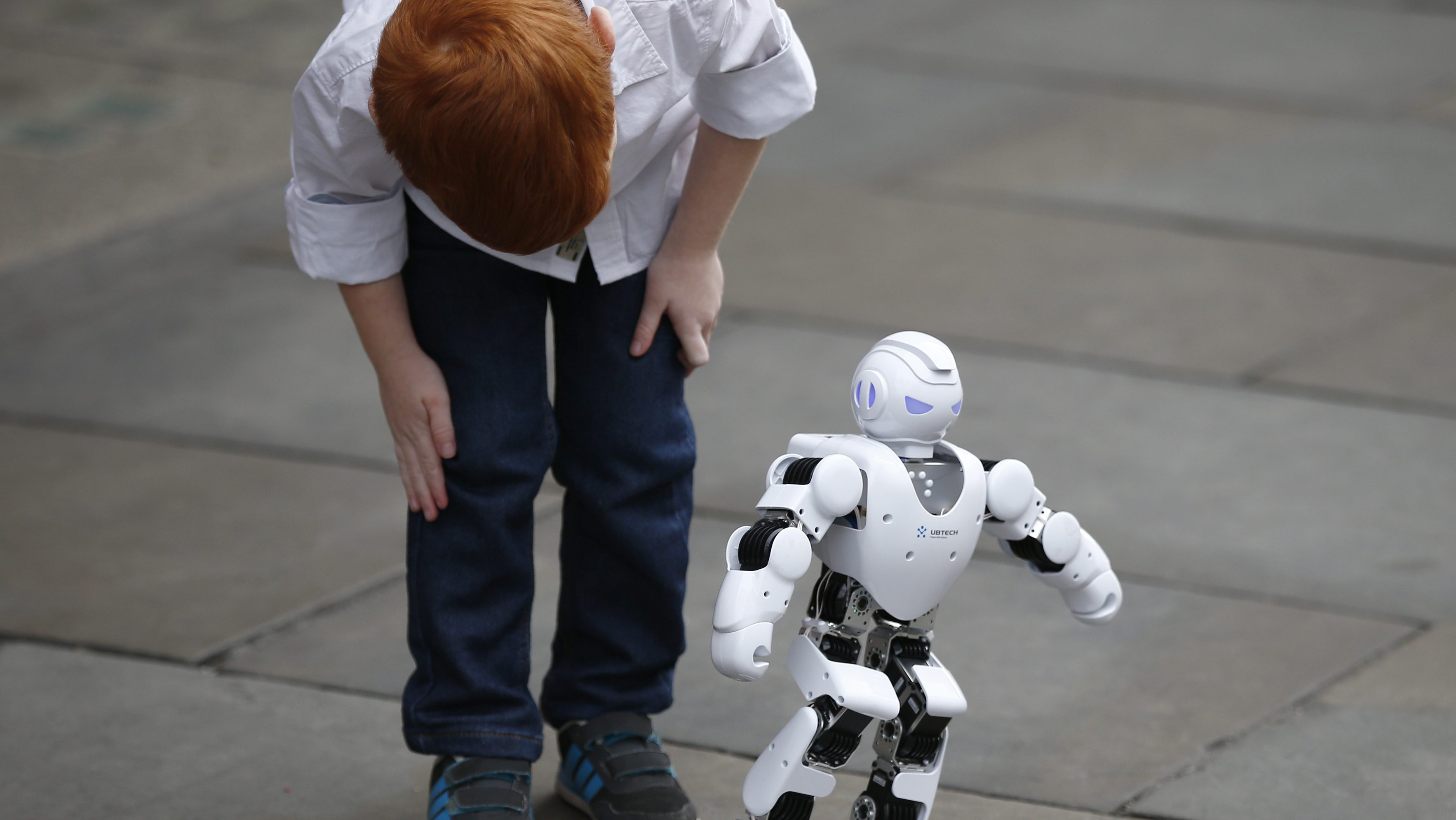 The Alpha 1S Robot is observed by Tristan Robertson-Jeyes, aged five, at the launch of Hamley's predicted top ten toys that will be on children's lists this Christmas, in London, Britain October 6, 2016.