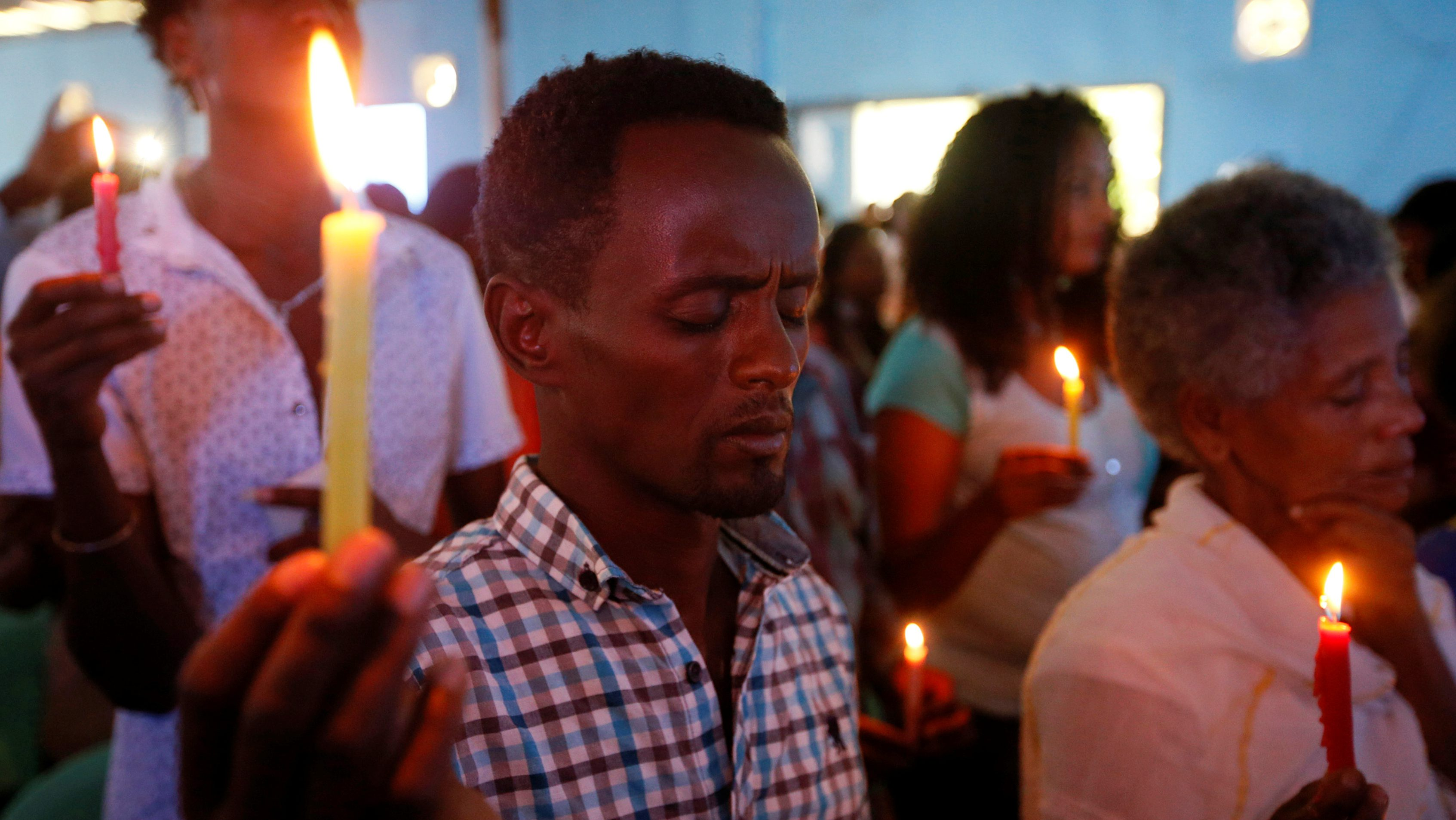 People attend prayer session at Biftu Bole Lutheran Church during a prayer and candle ceremony for protesters who died in the town of Bishoftu a week ago during Ireecha, the thanksgiving festival for the Oromo people, Addis Ababa, Ethiopia, October 9, 2016.