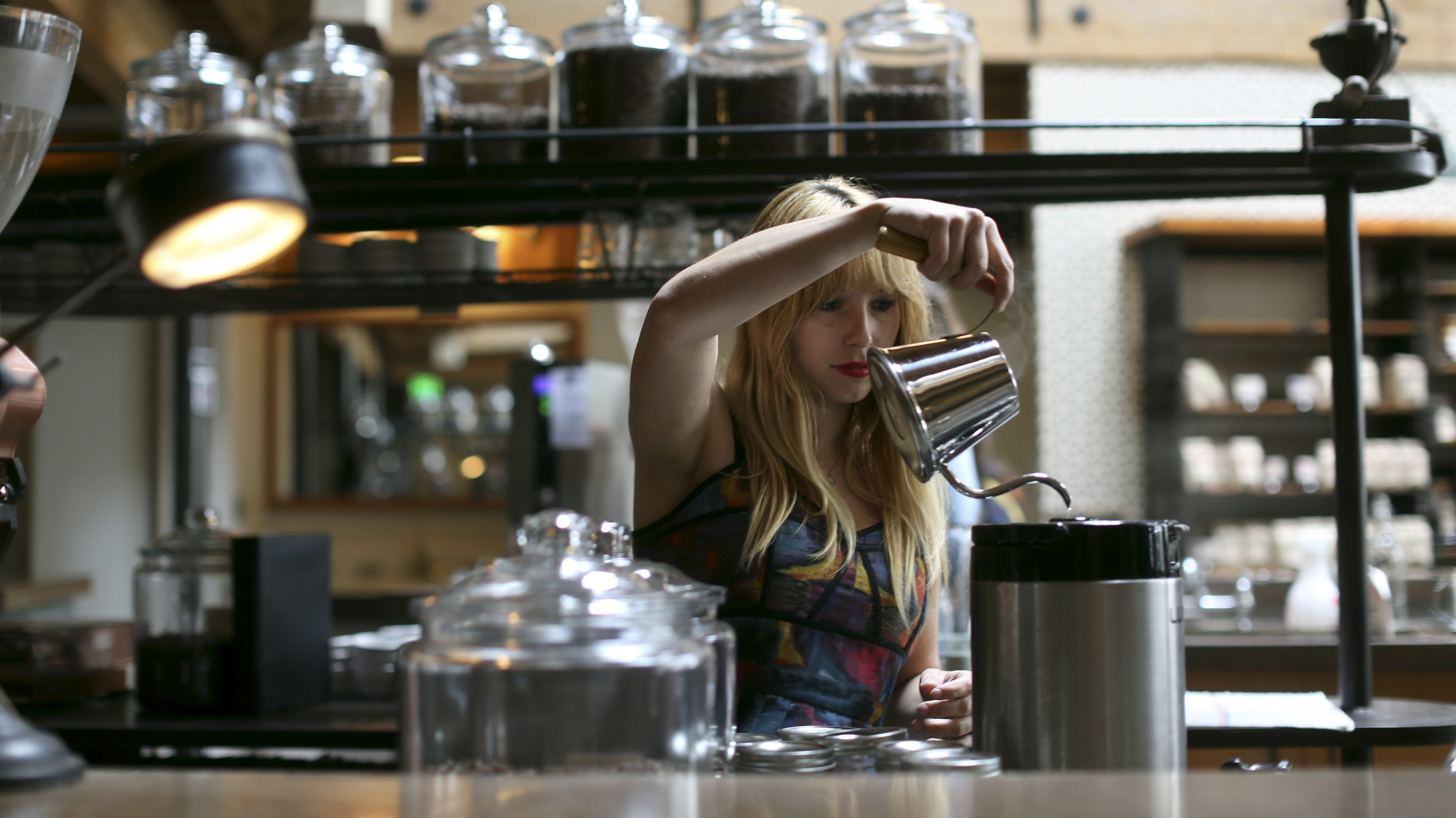 A barista prepares a coffee drink at Sightglass, a coffee bar and roastery, in San Francisco