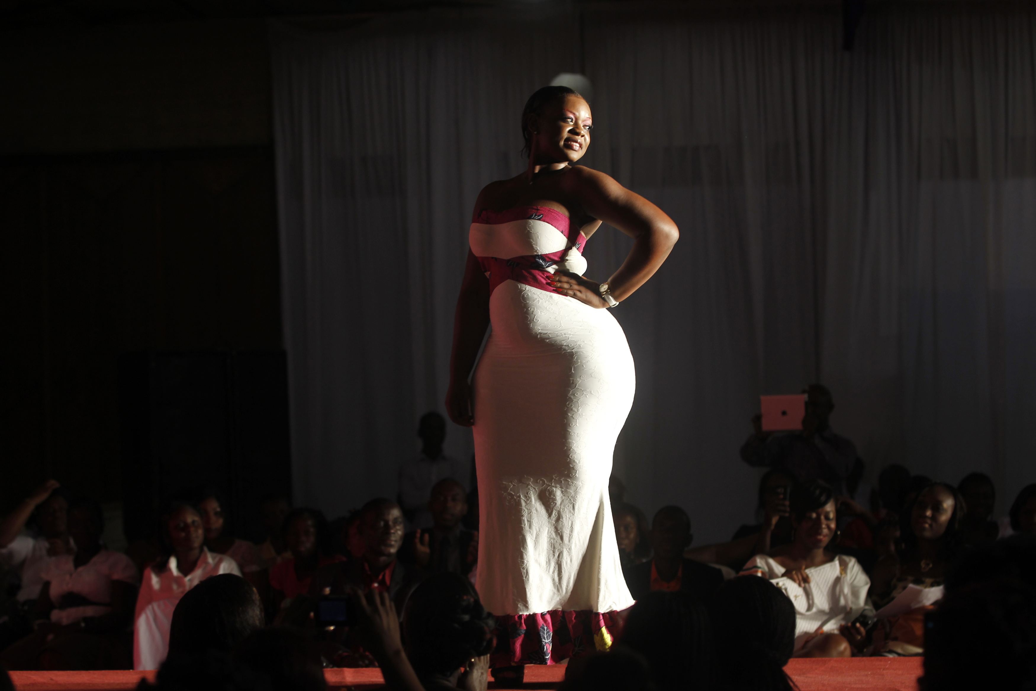 A model presents a creation during the Miss Rondement Belle fashion show in Abidjan October 30, 2013. The fashion show, which takes place till October 31 and has other activities such as a Miss Curvy contest, is aimed at emphasizing that curvy women are beautiful, according to organizers.