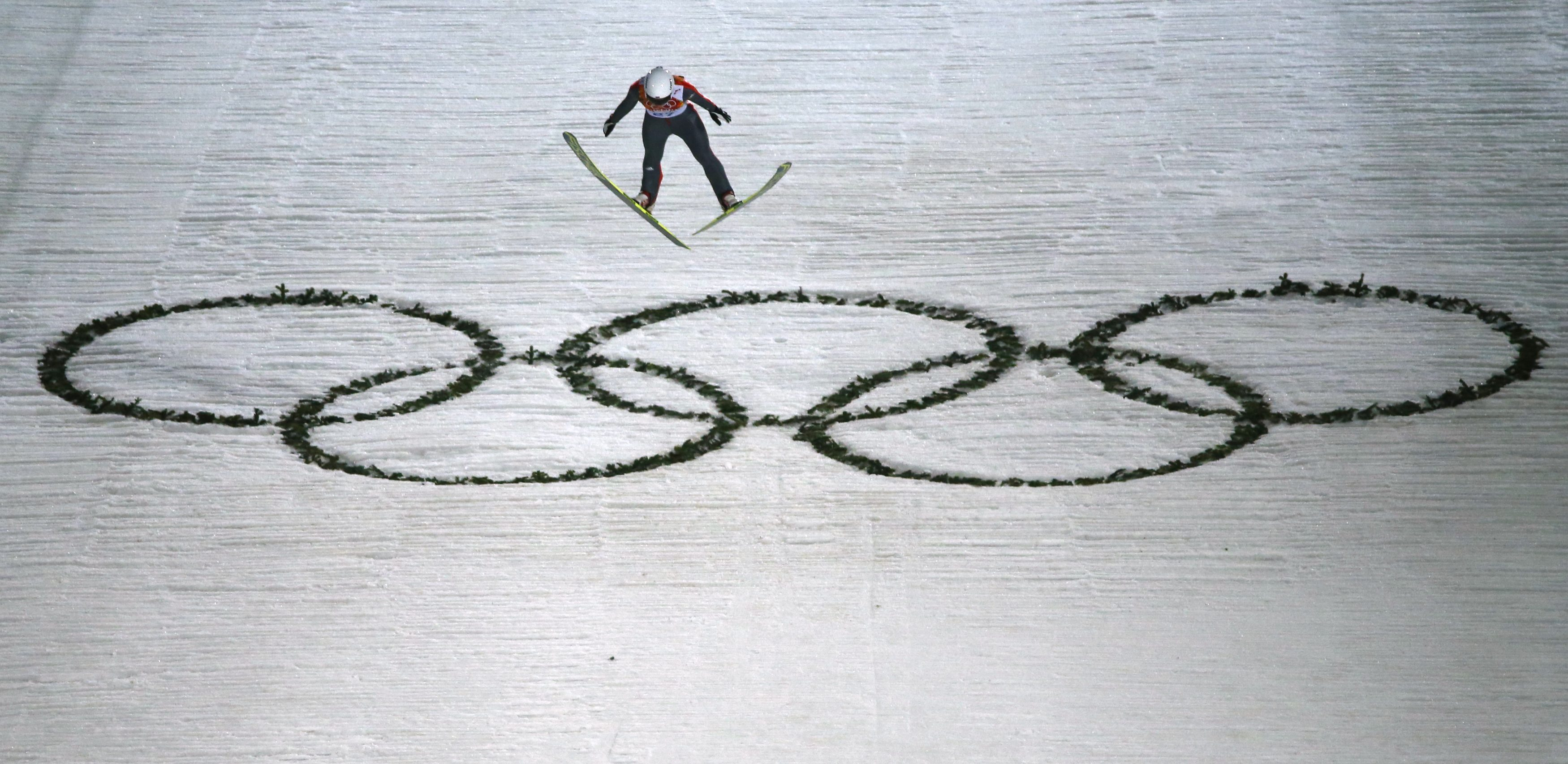 Russia's Irina Avvakumova soars through the air in the final round of the women's ski jumping individual normal hill event at the Sochi 2014 Winter Olympic Games, at the RusSki Gorki Jumping Centre, in Rosa Khutor.