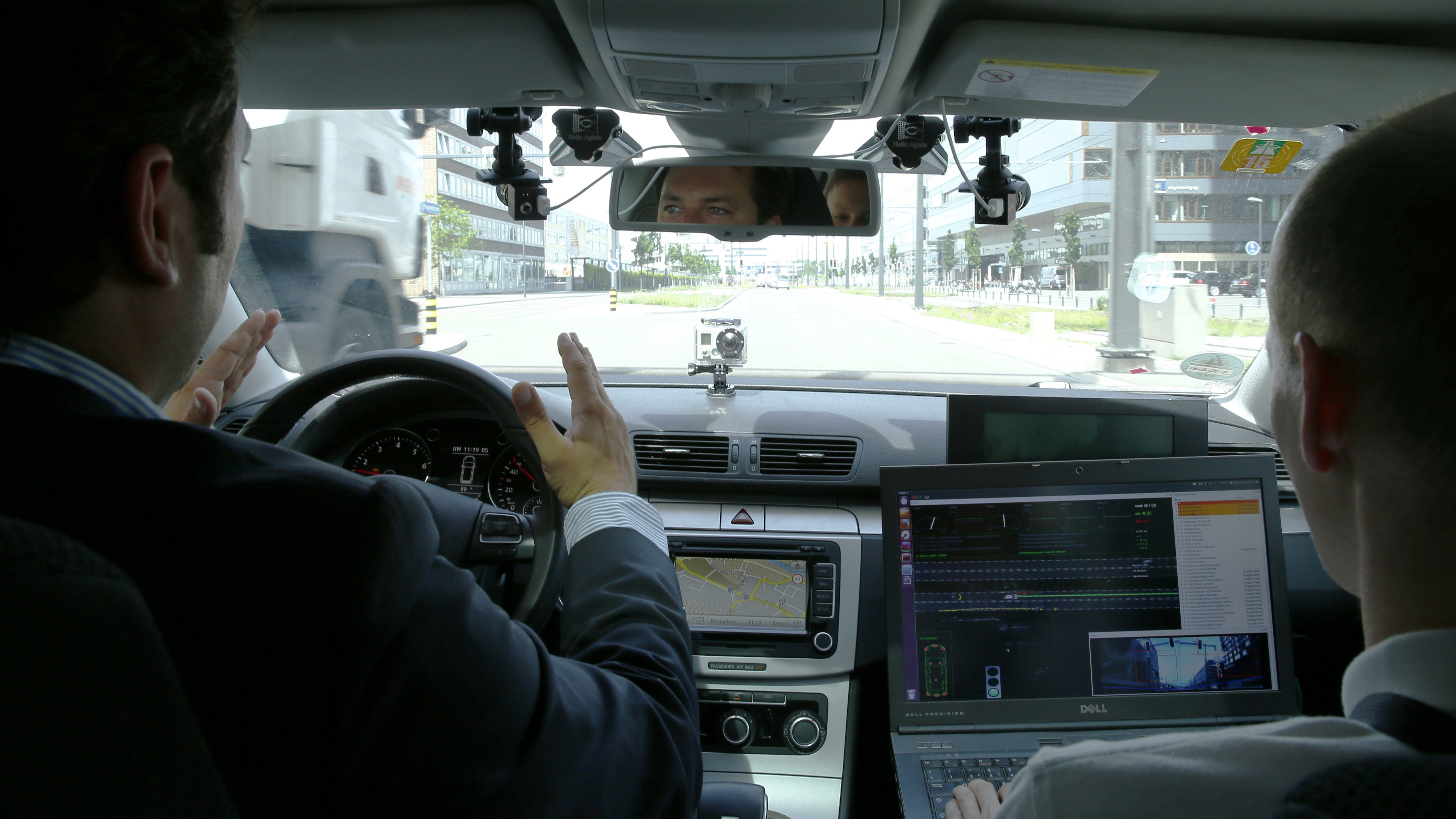 Two men in a self-driving car.