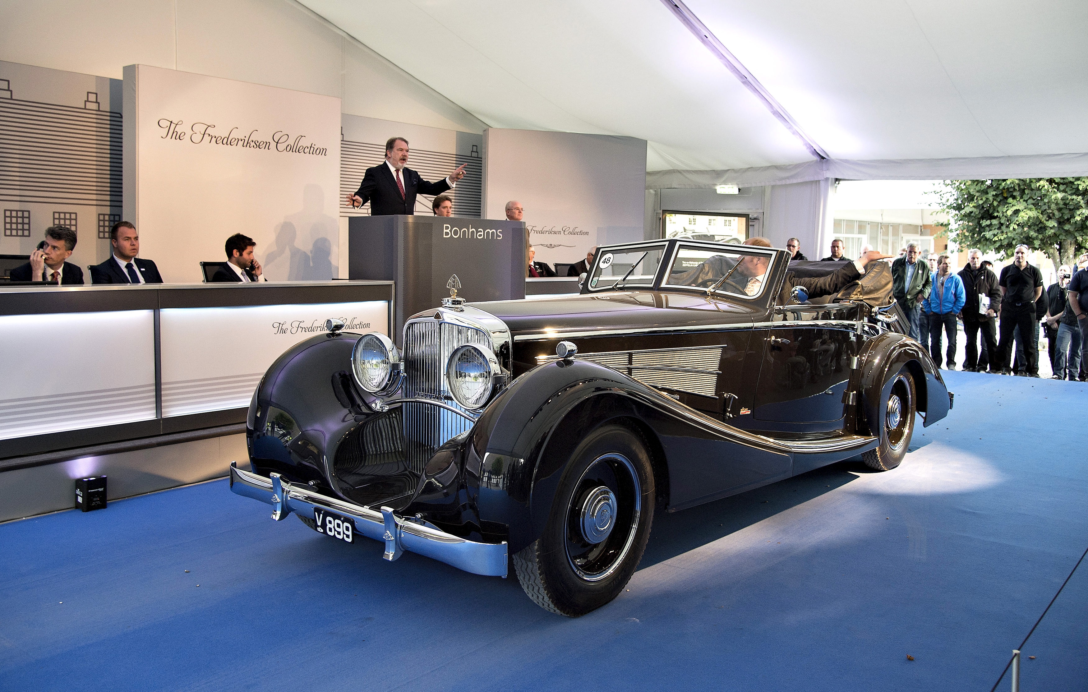 People look at an antique car from the Frederiksen Collection which are up for auction through the British auction house Bonhams, at Mr. Frederiksens manor in Mols Bjerge national park, eastern Jutland, Denmark September 26, 2015. The single-owned collection consists of 48 rare and iconic motor cars, all offered at the auction taking place at the home of owner Henrik Frederiksen. The sale features predominantly pre-war motor cars, built by some of the worlds most exclusive manufacturers, including Rolls-Royce, Bentley, Mercedes-Benz, Lagonda and Maybach. ATTENTION EDITORS - THIS IMAGE WAS PROVIDED BY A THIRD PARTY. FOR EDITORIAL USE ONLY. NOT FOR SALE FOR MARKETING OR ADVERTISING CAMPAIGNS. THIS PICTURE IS DISTRIBUTED EXACTLY AS RECEIVED BY REUTERS, AS A SERVICE TO CLIENTS. DENMARK OUT. NO COMMERCIAL OR EDITORIAL SALES IN DENMARK. NO COMMERCIAL SALES. - GF10000222116