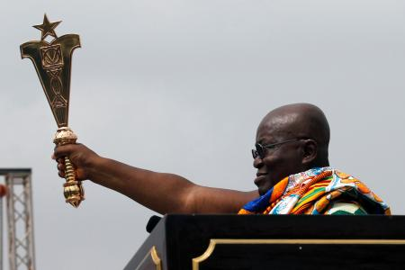 Ghana's new President Nana Akufo-Addo lifts up a staff of office during the swearing-in ceremony at Independence Square in Accra, Ghana. The West African nation also celebrated 60 years since independence.