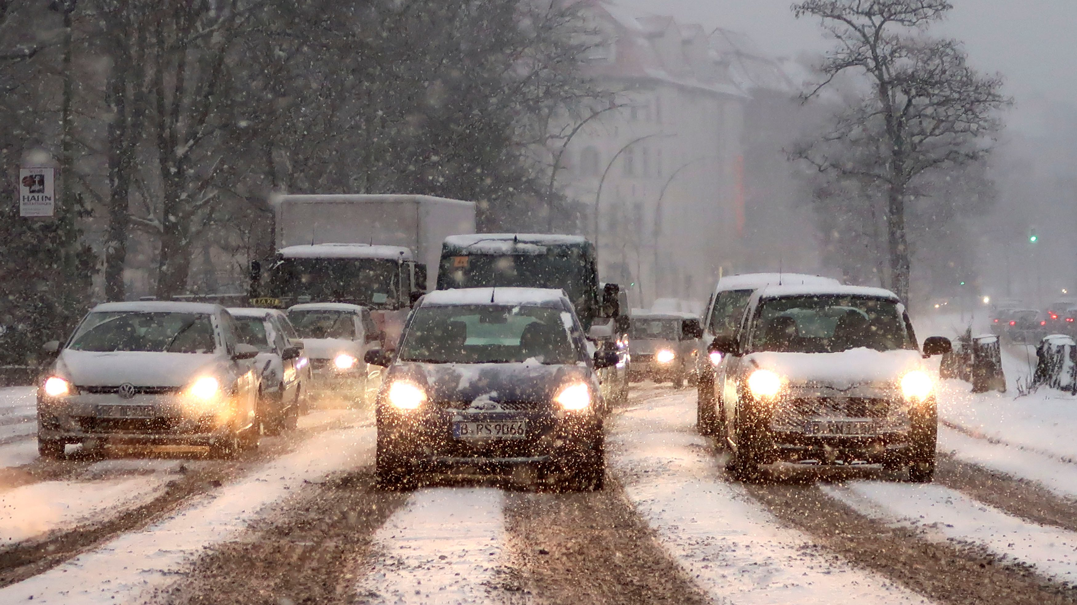 Cars drive on a street during a heavy snow fall in Berlin, Germany.
