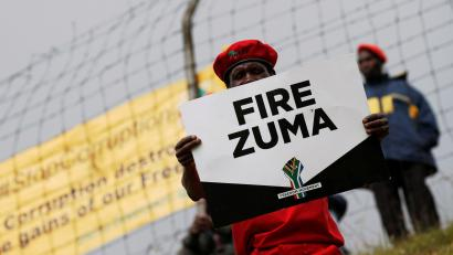 Supporters of various opposition parties hold placards calling for the removal of President Jacob Zuma outside the Constitutional Court in Johannesburg, South Africa, May 15, 2017.