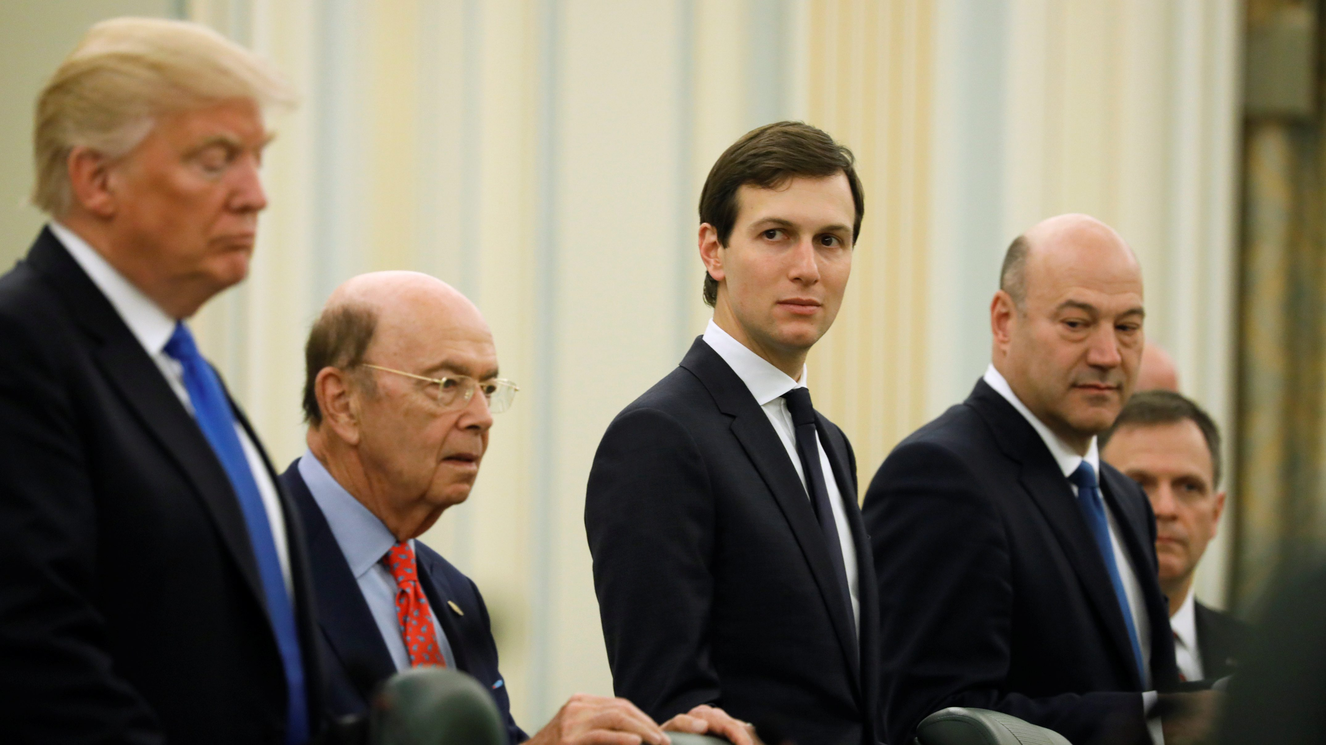 White House senior advisor Jared Kushner (C) sits alongside U.S. President Donald Trump (L), Commerce Secretary Wilbur Ross (2nd L) and chief economic advisor Gary Cohn (R) as they prepare to meet with Saudi Arabia's King Salman bin Abdulaziz Al Saud and the Saudi delegation at the Royal Court in Riyadh, Saudi Arabia May 20, 2017.  - RC1F32AC97C0