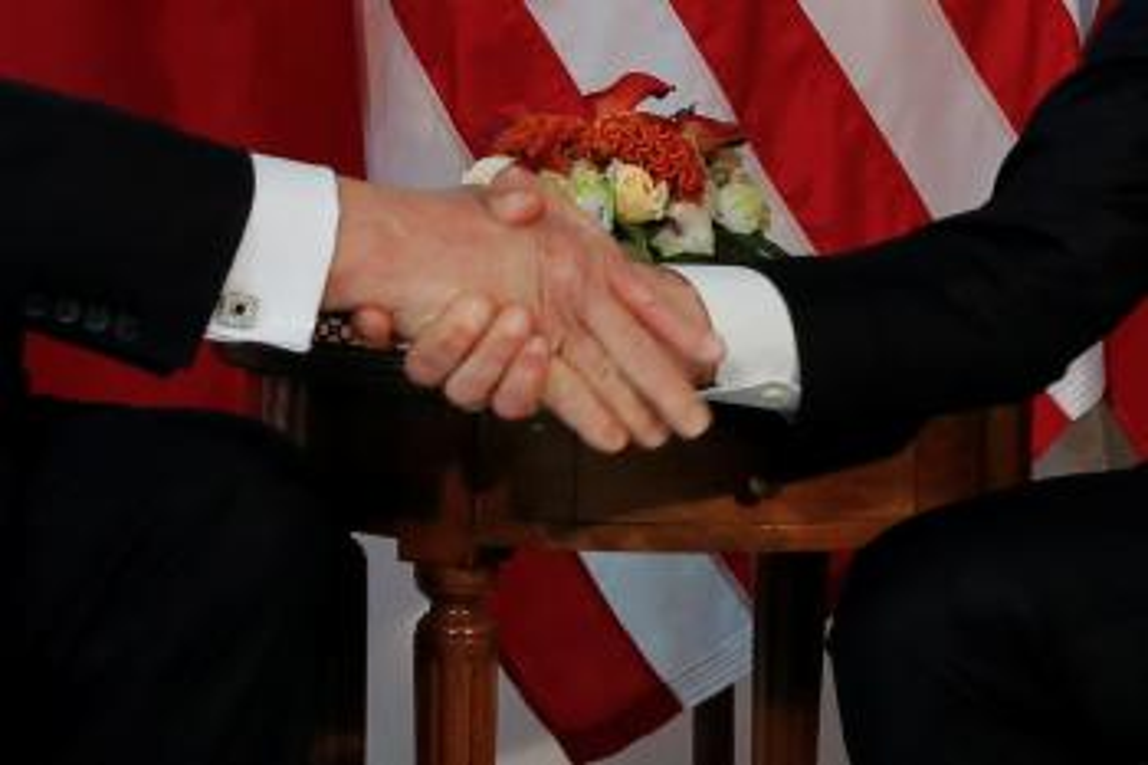 Close-up of Trump (L) and Macrons handshake.