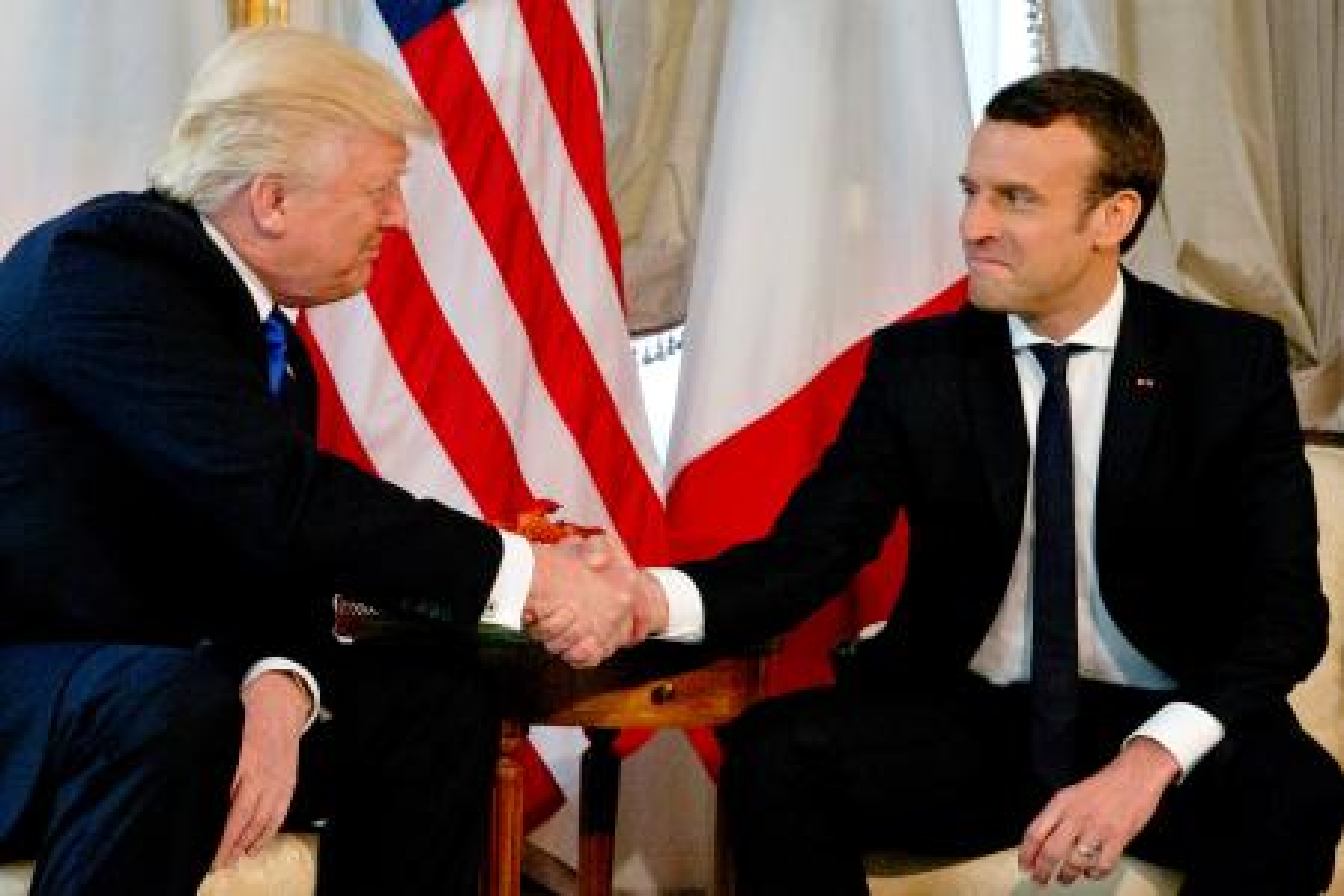 Macron Trump handshake