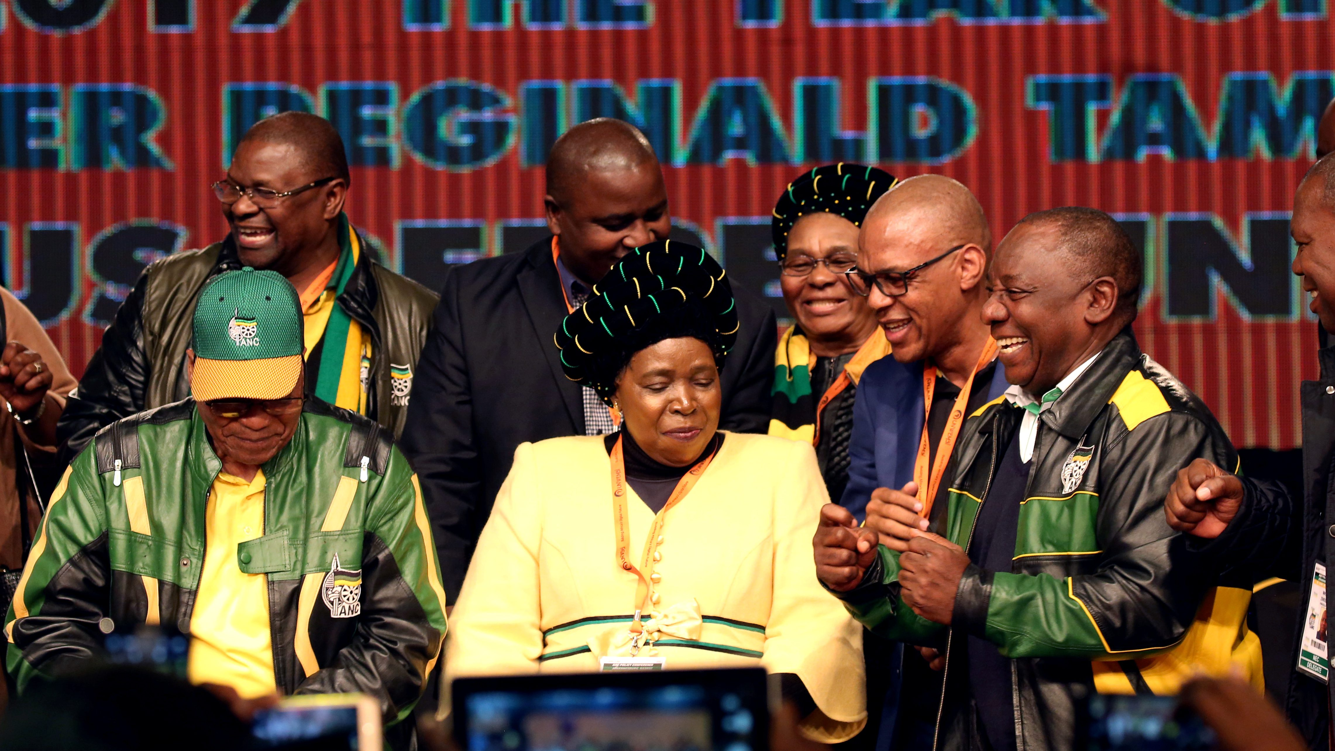 South Africa's President Jacob Zuma dances with former African Union chairperson Nkosazana Dlamini-Zuma and South Africa's Deputy President Cyril Ramaphosa during the last day of the six-day meeting of the African National Congress 5th National Policy Conference at the Nasrec Expo Centre in Soweto, South Africa, July 5, 2017.