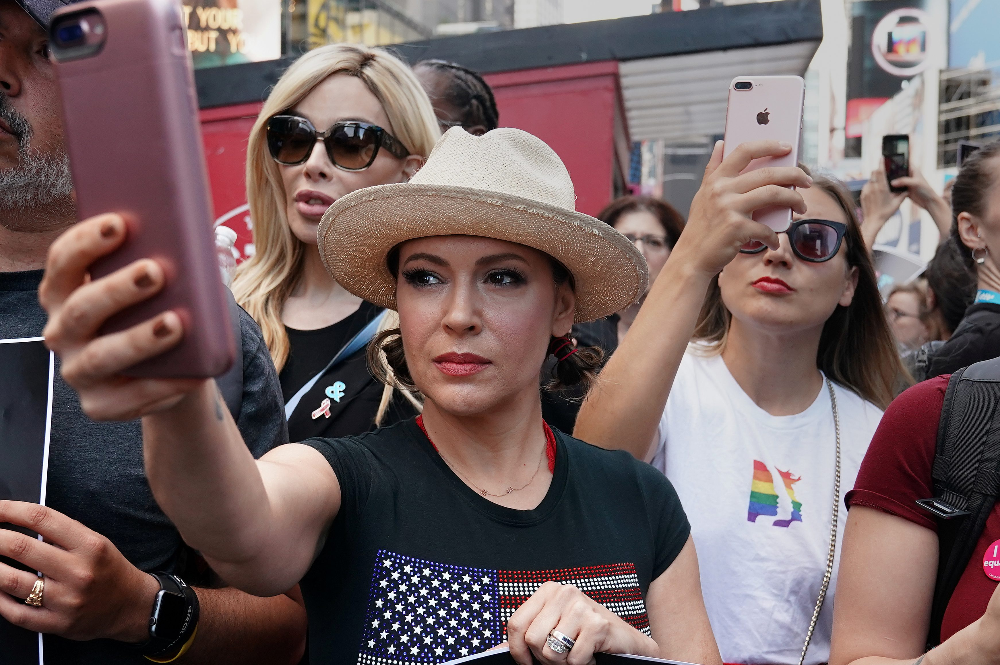 Actress Alyssa Milano attends a protest