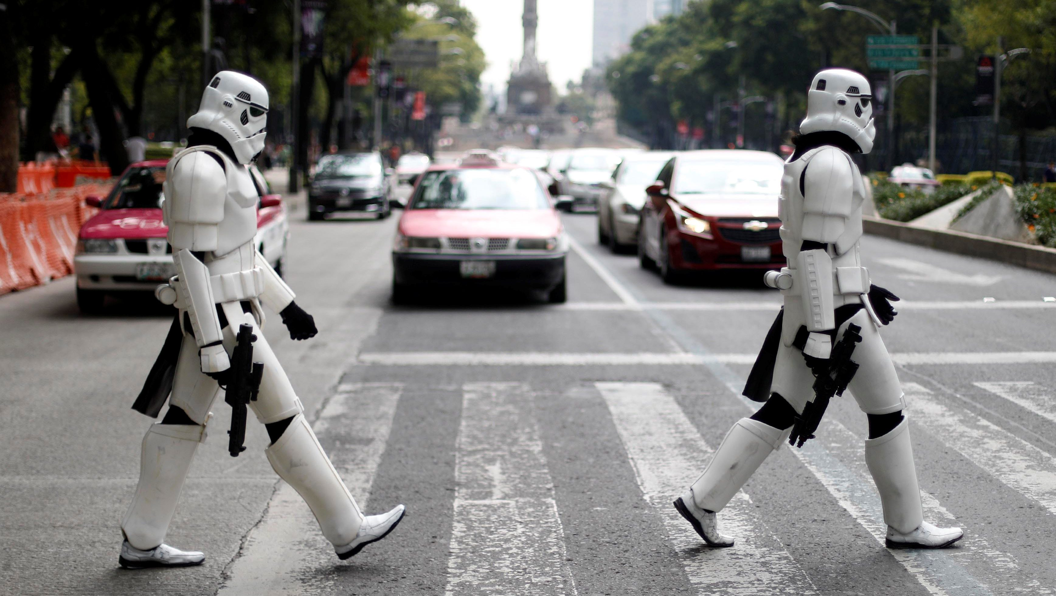 Two people dressed as Star Wars Storm Troopers cross Reforma Avenue in Mexico City, Mexico, August 26, 2017.