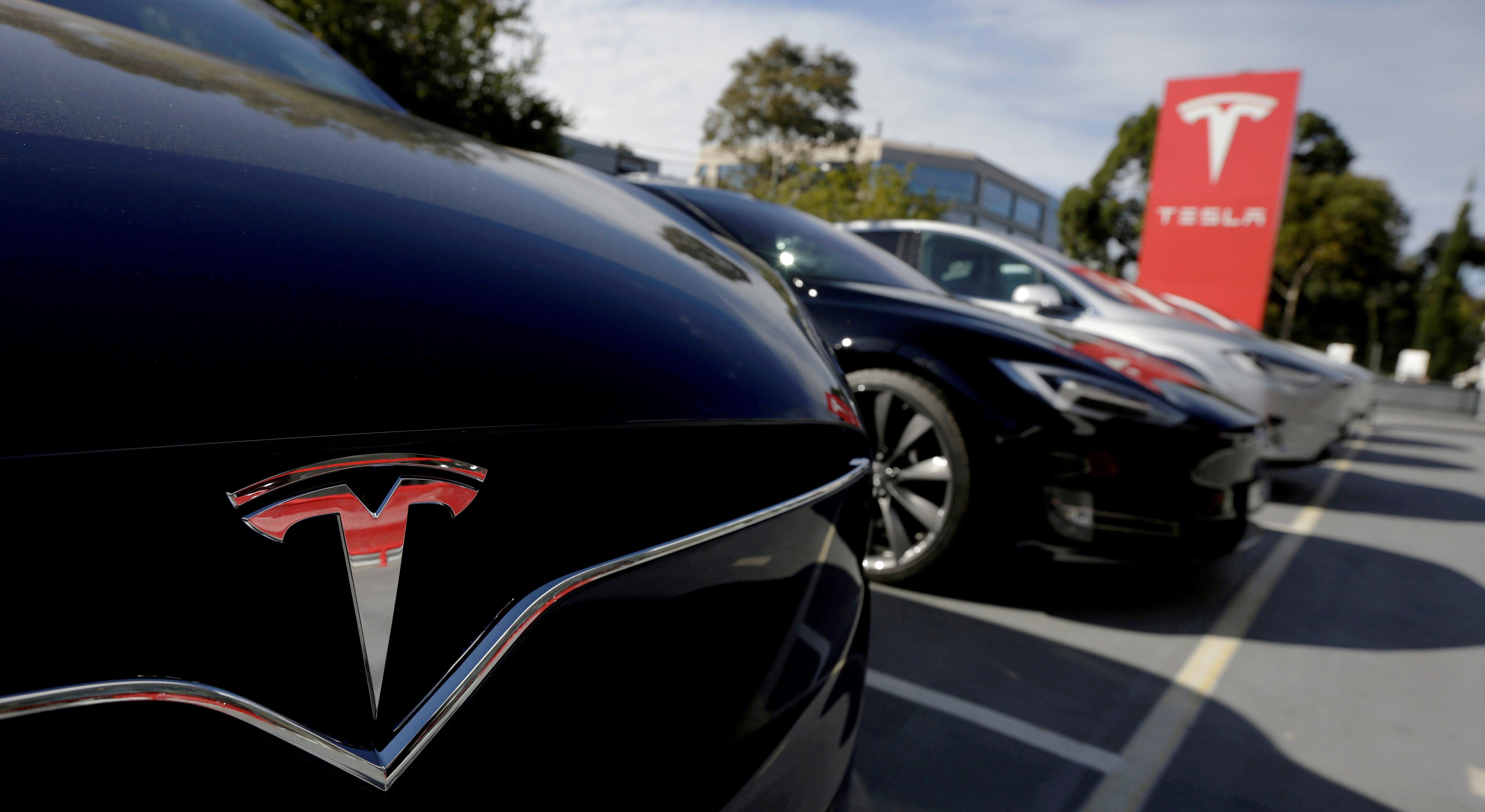 A Tesla Model X is seen alongside a Model S at a Tesla electric car dealership in Sydney, Australia.