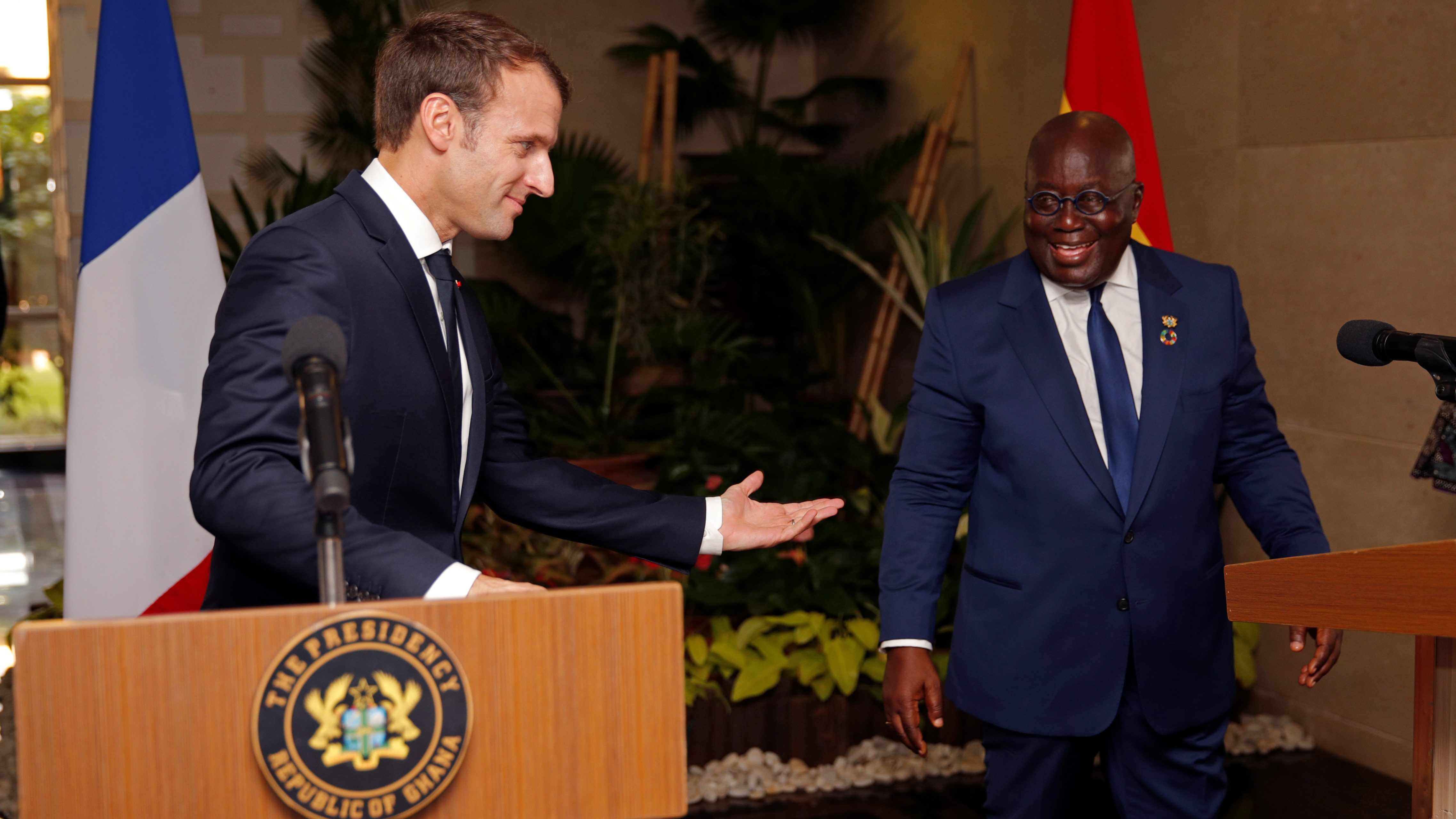 French President Emmanuel Macron speaks with Ghana's President Nana Akufo-Addo in Accra