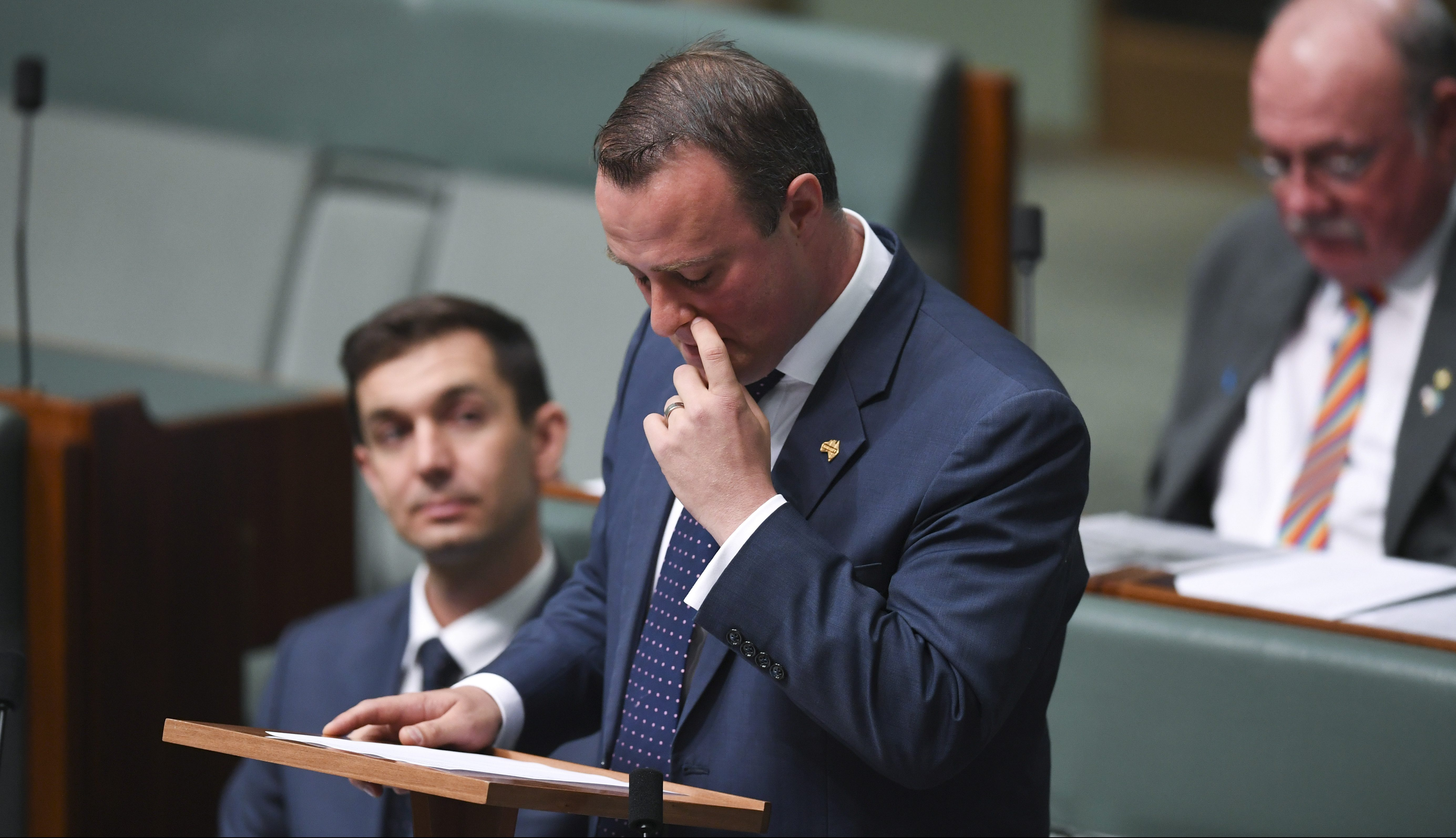 Liberal MP Tim Wilson reacts after proposing to his partner Ryan Bolger during debate of the Marriage Amendment bill in the House of Representatives at Parliament House in Canberra