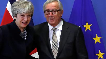 Britain's PM May is welcomed by EU Commission President Juncker at the European Commission in Brussels