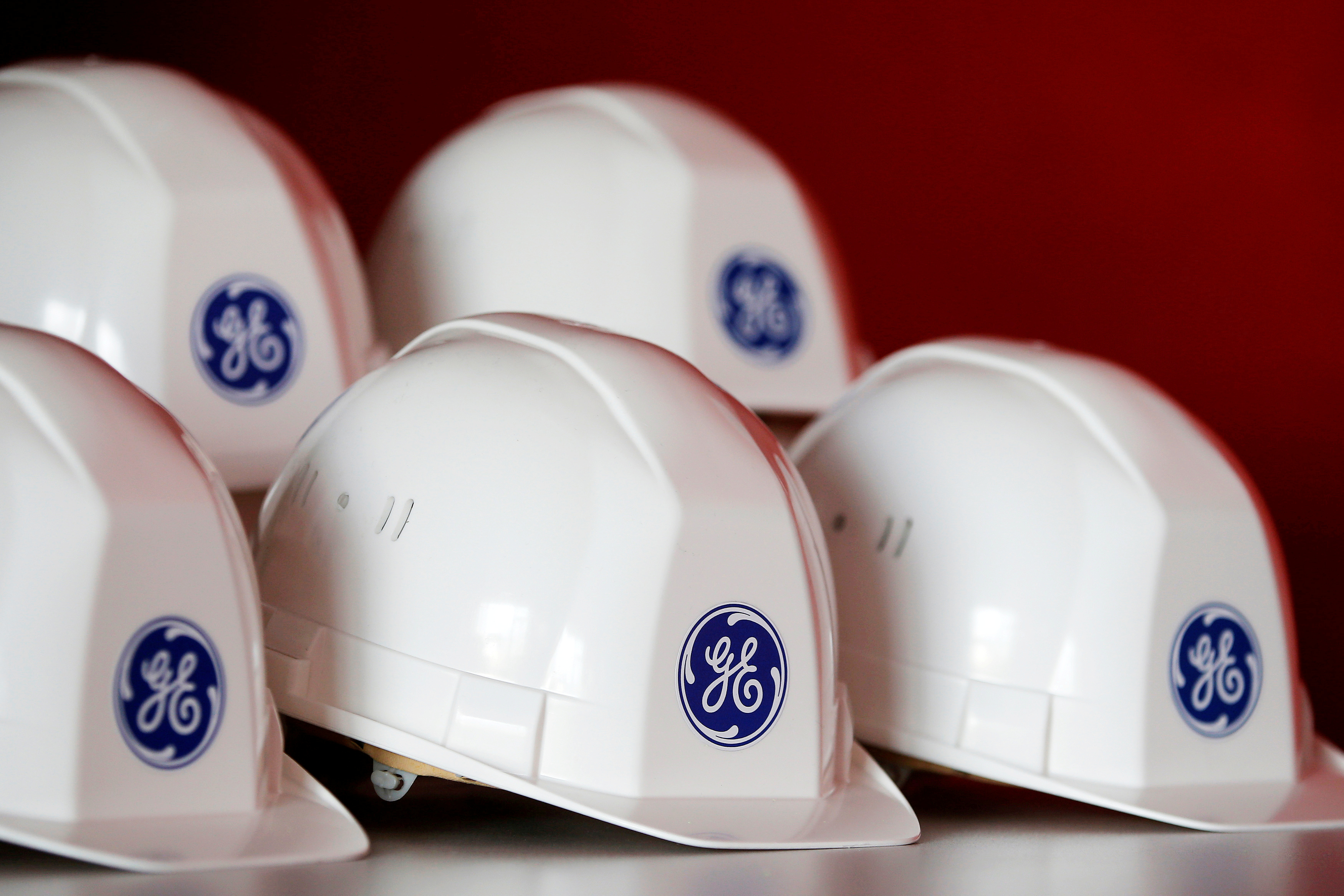 The General Electric logo is pictured on working helmets during a visit at the General Electric offshore wind turbine plant in Montoir-de-Bretagne