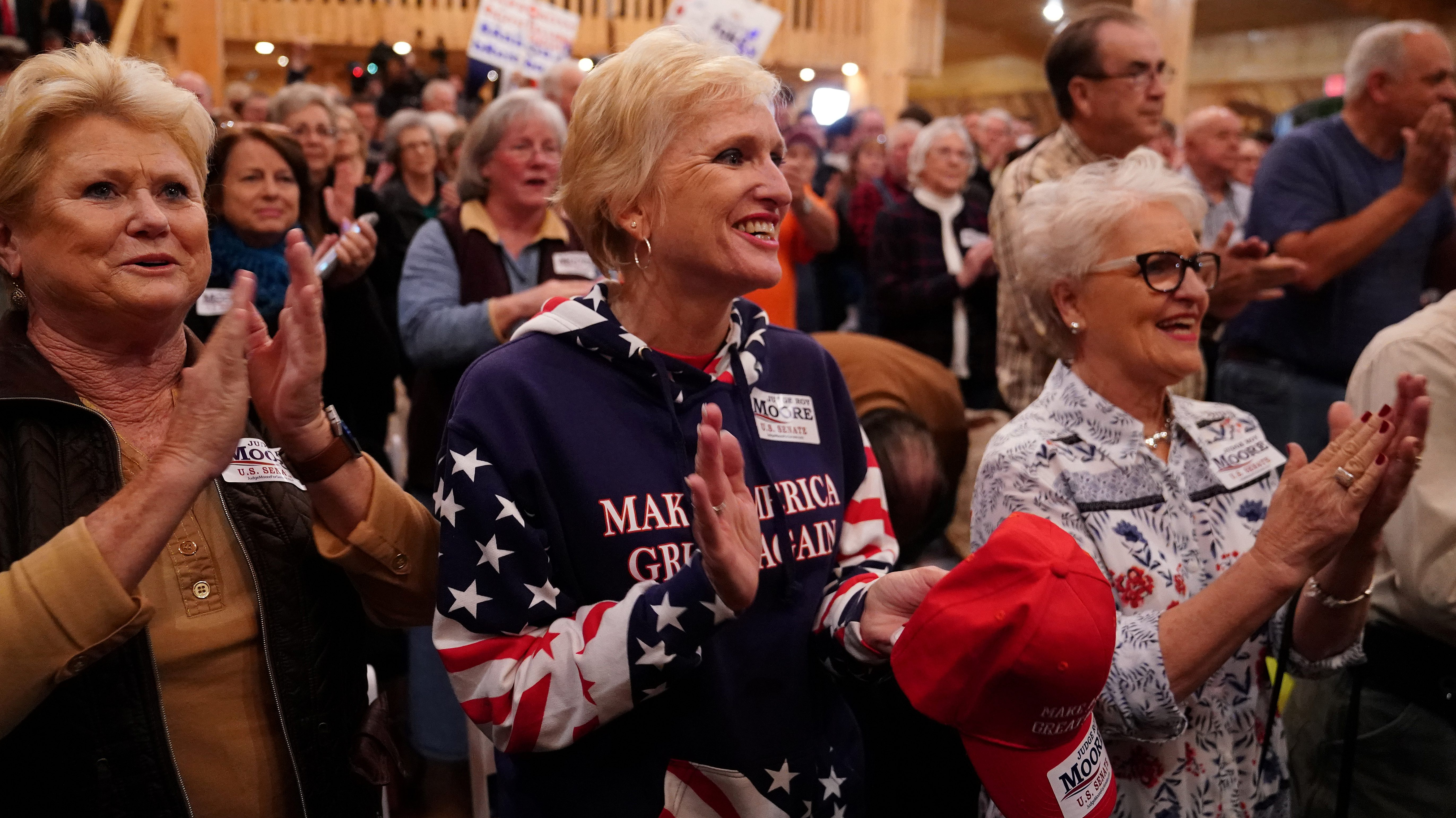 Supporters cheer at a Republican Senate candidate Roy Moore campaign rally in Midland City, Alabama
