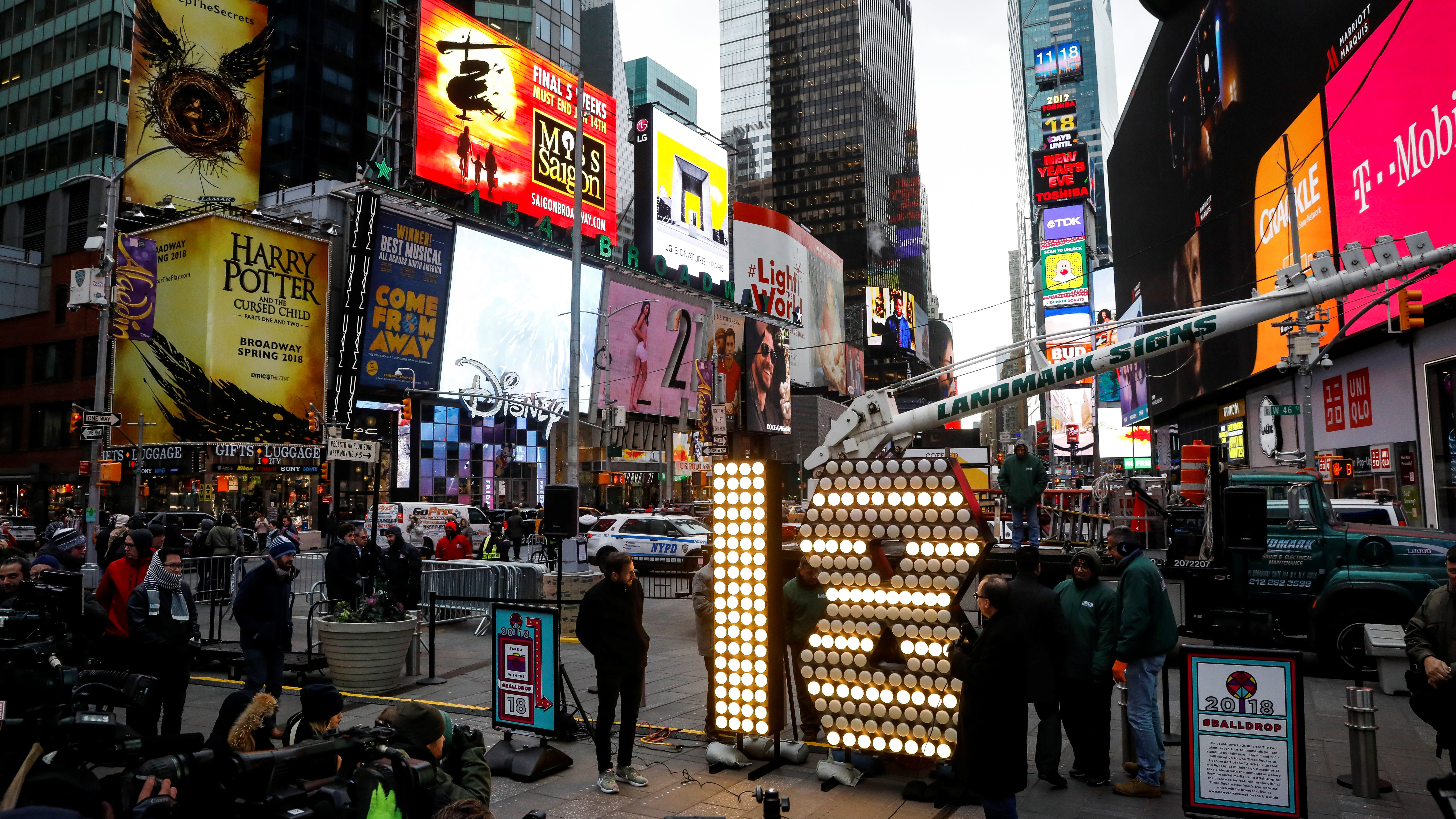 """The """"18"""" Numerals are turned on after being delivered to be placed atop 1 Times Square for the New Year's Eve ball drop in New York City, U.S., December 13, 2017. REUTERS/Brendan McDermid - RC13D2F79540"""