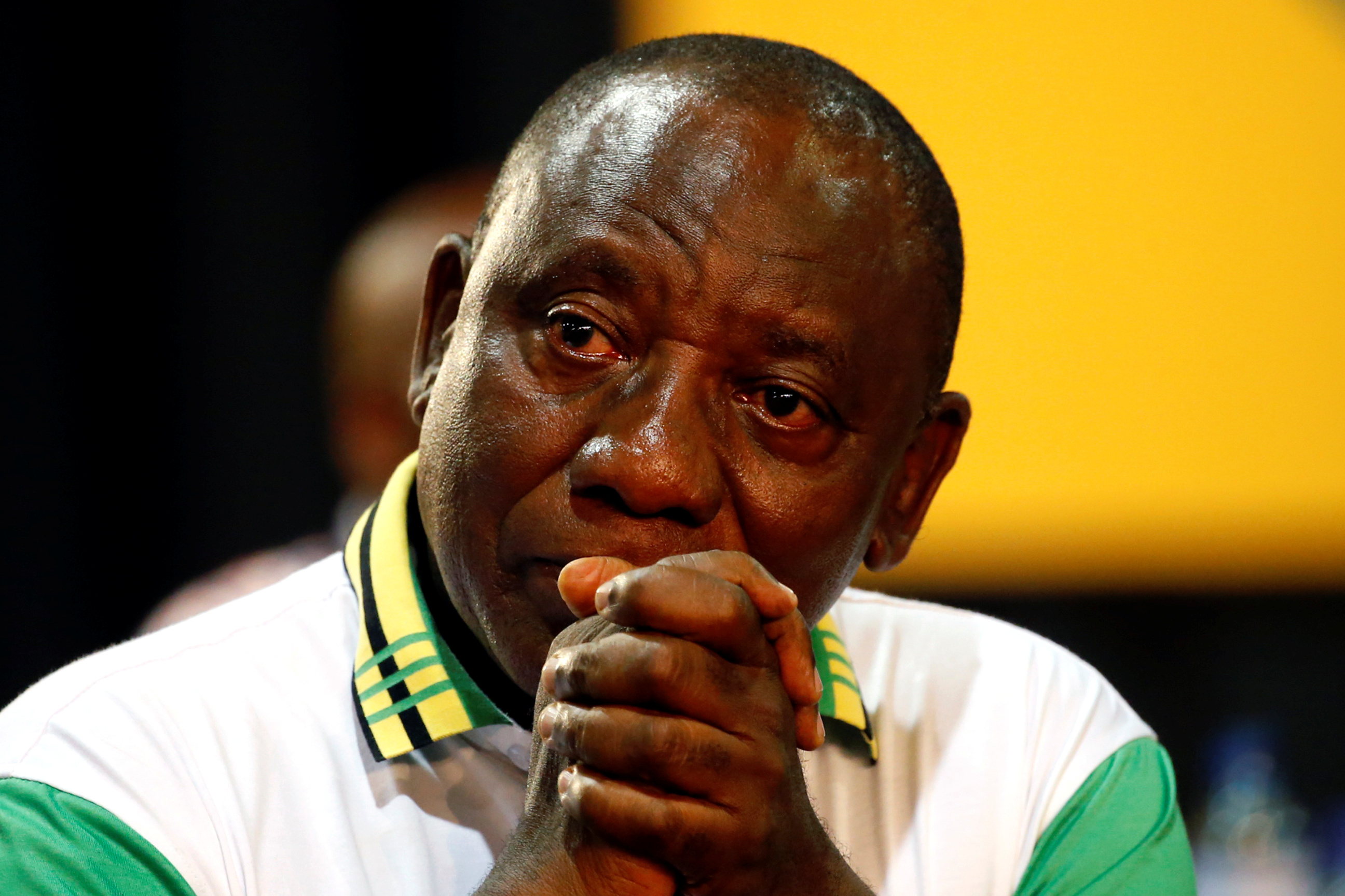 Deputy president of South Africa Cyril Ramaphosa reacts after he was elected president of the ANC during the 54th National Conference of the ruling African National Congress (ANC) at the Nasrec Expo Centre in Johannesburg, South Africa December 18, 2017. REUTERS/Siphiwe Sibeko - RC1289F77440