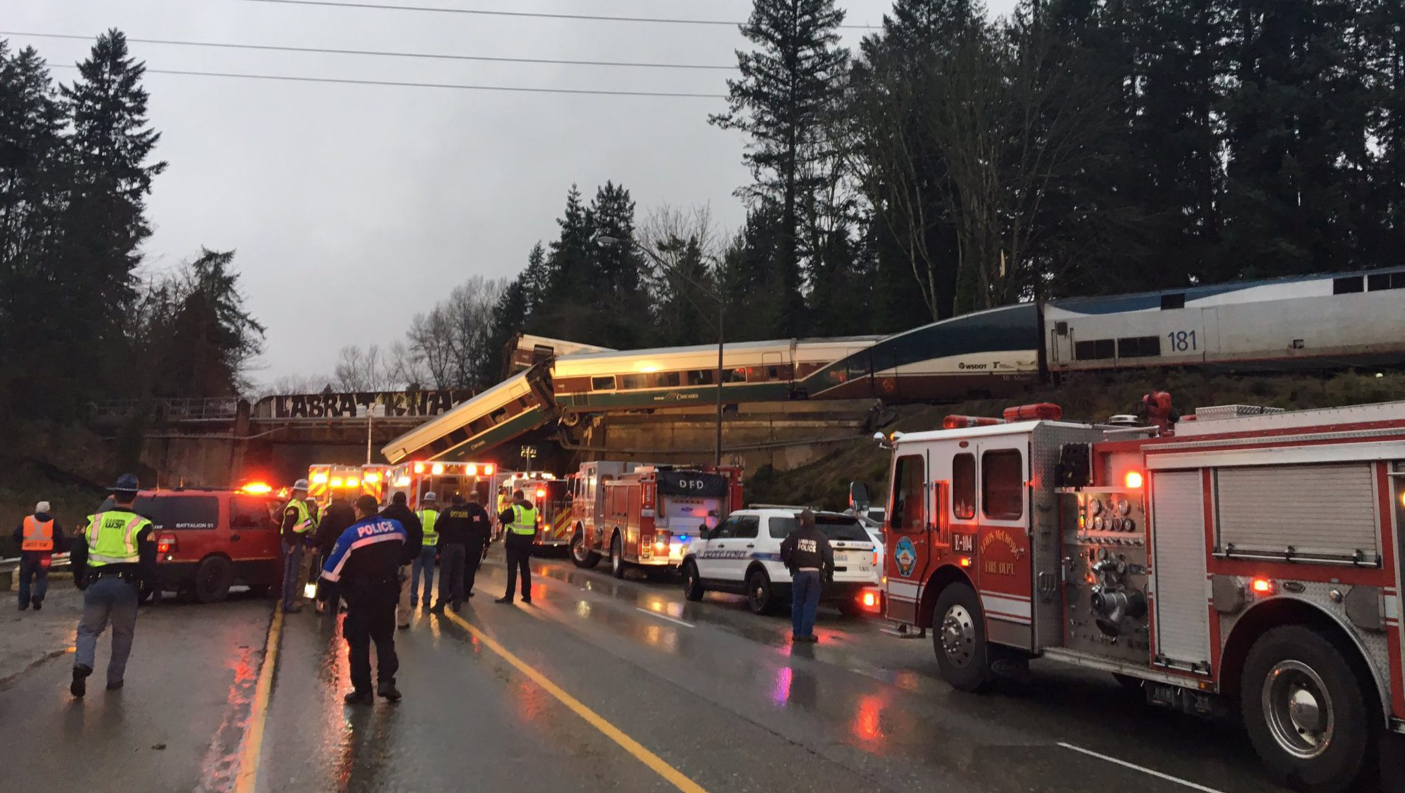 First responders are seen at the scene of an Amtrak passenger train derailment on interstate highway (I-5) in this Washington State Patrol image moved on social media in DuPont, Washington, U.S.