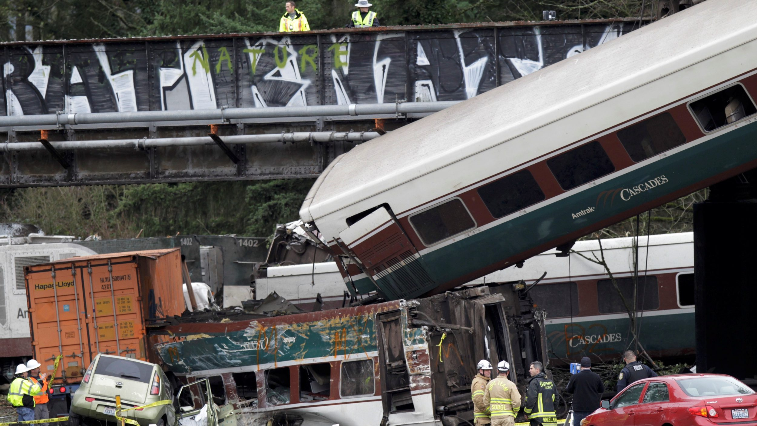 The scene where an Amtrak passenger train derailed on a bridge over interstate highway I-5  in DuPont, Washington, U.S. December 18, 2017.  - RC1EC6AB74D0