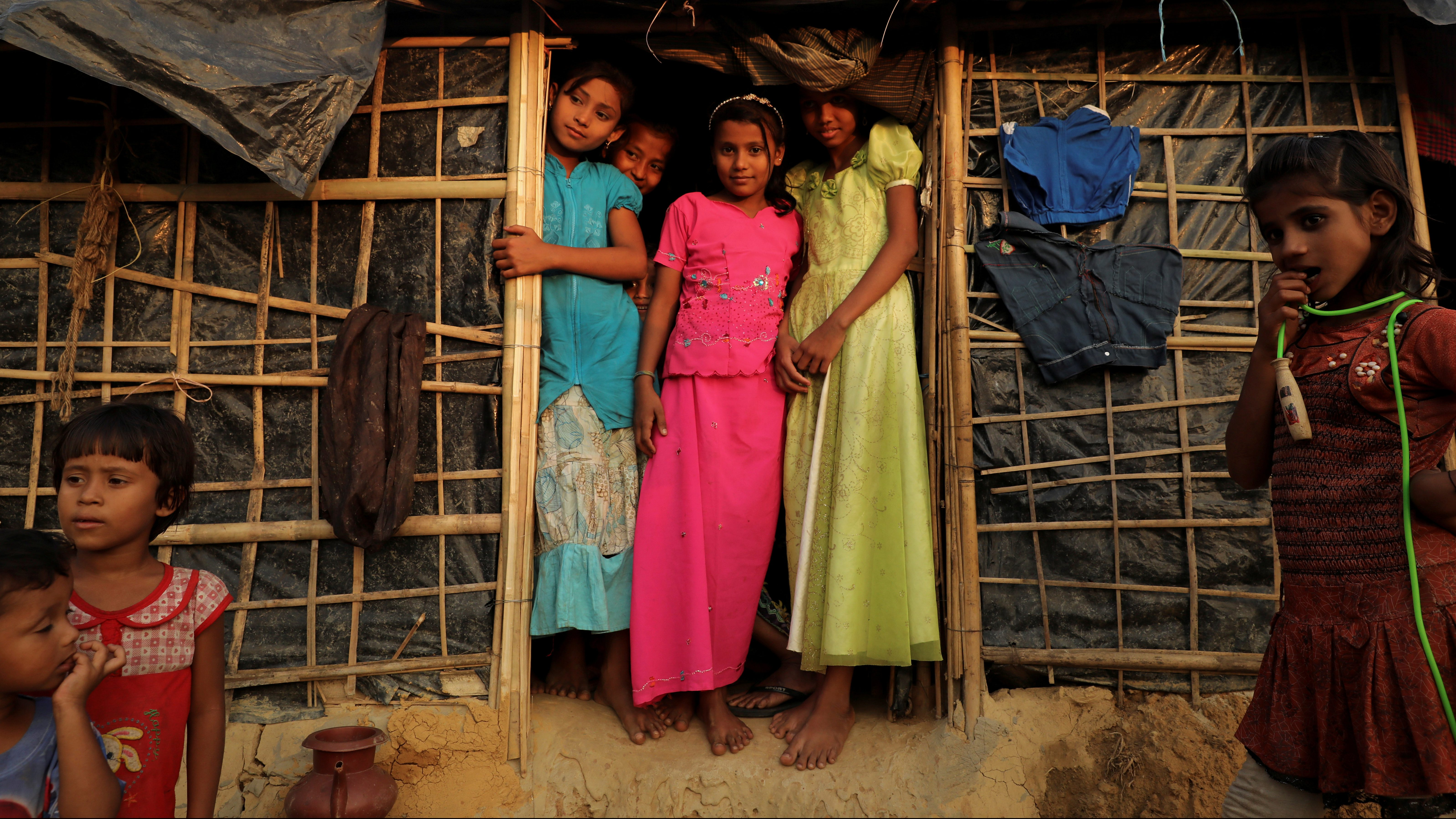 Rohingya children refugees stand in front of their temporary shelters