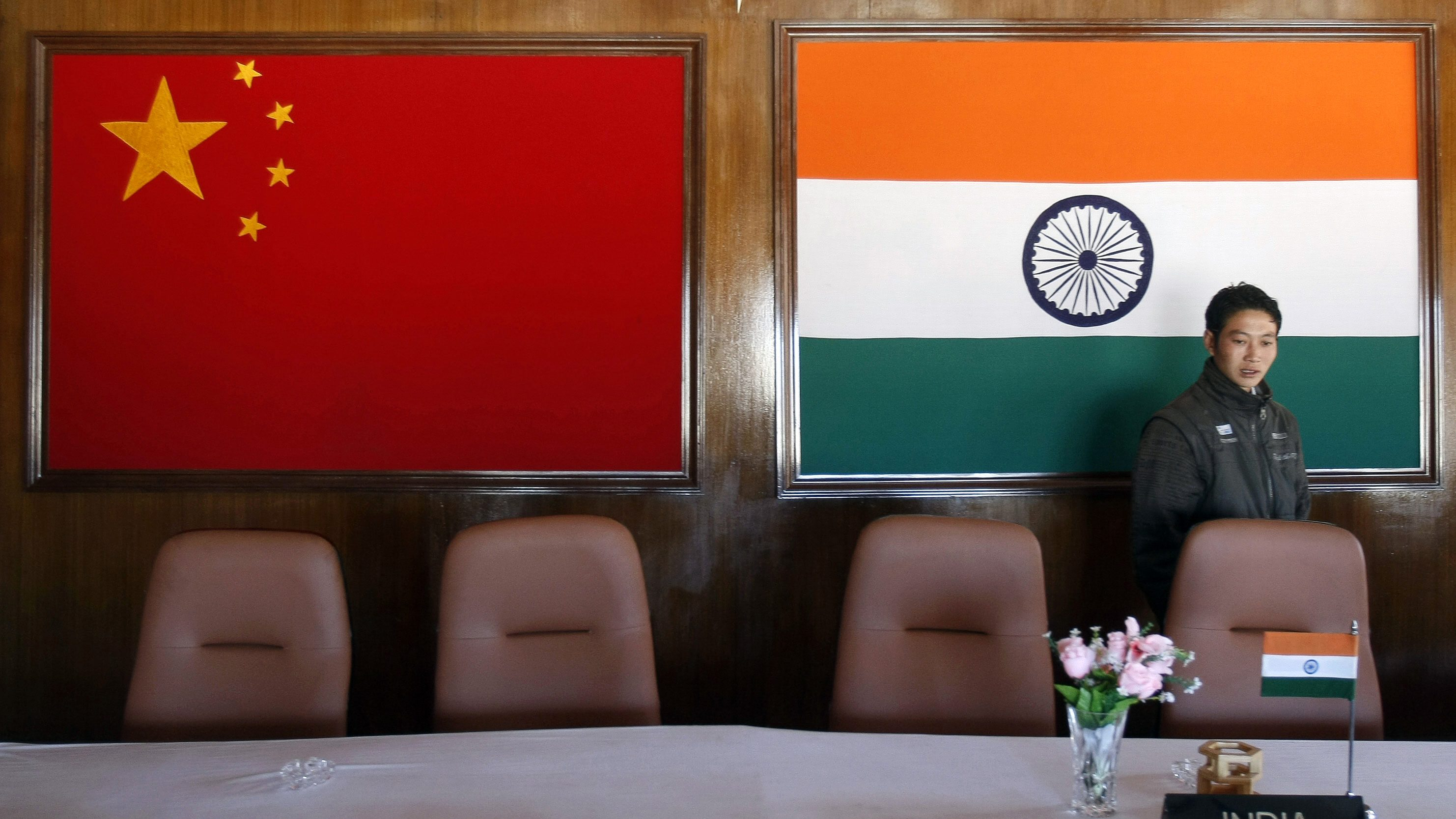 A man walks inside a conference room used for meetings between military commanders of China and India, at the Indian side of the Indo-China border at Bumla, in the northeastern Indian state of Arunachal Pradesh, November 11, 2009. With ties between the two Asian giants strained by a flare-up over their disputed boundary, India is fortifying parts of its northeast, building new roads and bridges, deploying tens of thousands more soldiers and boosting air defences. Picture taken November 11, 2009.    REUTERS/Adnan Abidi (INDIA POLITICS MILITARY IMAGES OF THE DAY) - GM1E5BD1AZ701