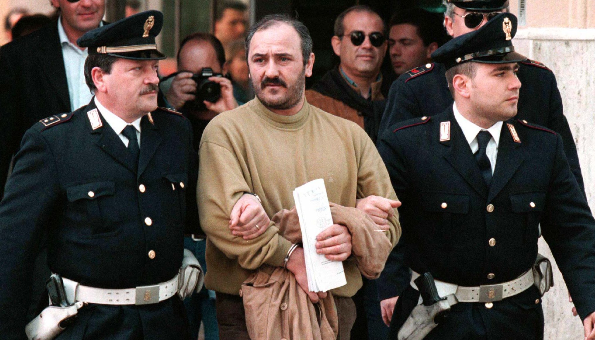 Vito Vitale, 39, a leading mobster widely believed to be the heir of jailed Mafia 'boss of bosses' Salvatore Toto Riina is escorted by Italian police to the jail in Palermo, Sicily, April 15. Vitale was ambushed by police at a farm estate where he was in hiding near the Sicilian capital of Palermo April 14.