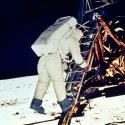 Astronaut Edwin E. Aldrin, Jr., lunar module pilot, descends steps of Lunar Module ladder as he prepares to walk on the moon, July 20, 1969. This picture was taken by astronaut Neil A. Armstrong, Commander, with a 70mm surface camera.