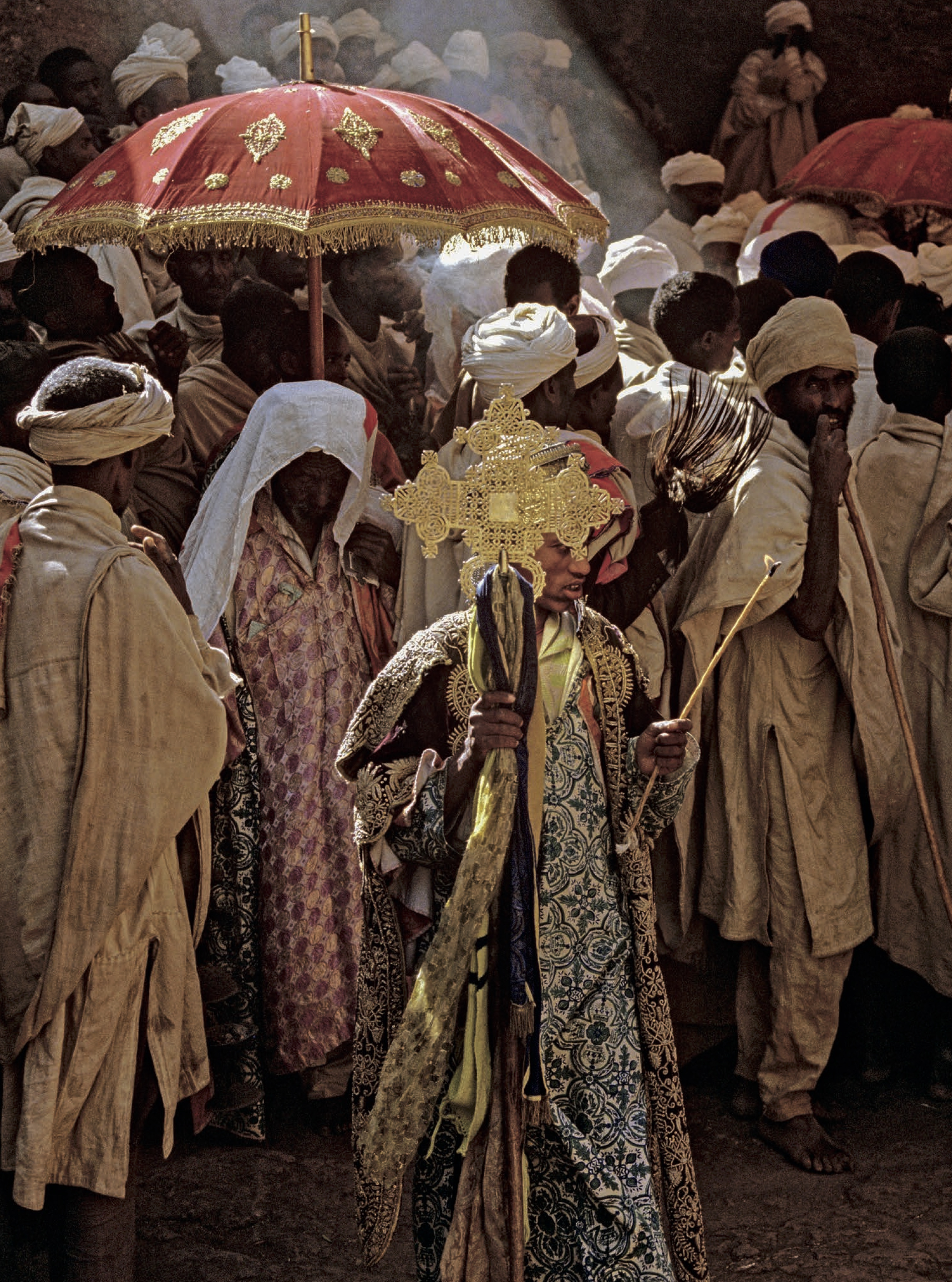 In this celebration at Lalibela, the tabots, covered in rich cloth and carried on the heads of priests, are taken out from all the churches and accompanied in a procession of priests, monks, deacons, debtaras, and pilgrims to where they will rest the night in a tent. The priests fast for eighteen hours before carrying the tabot.