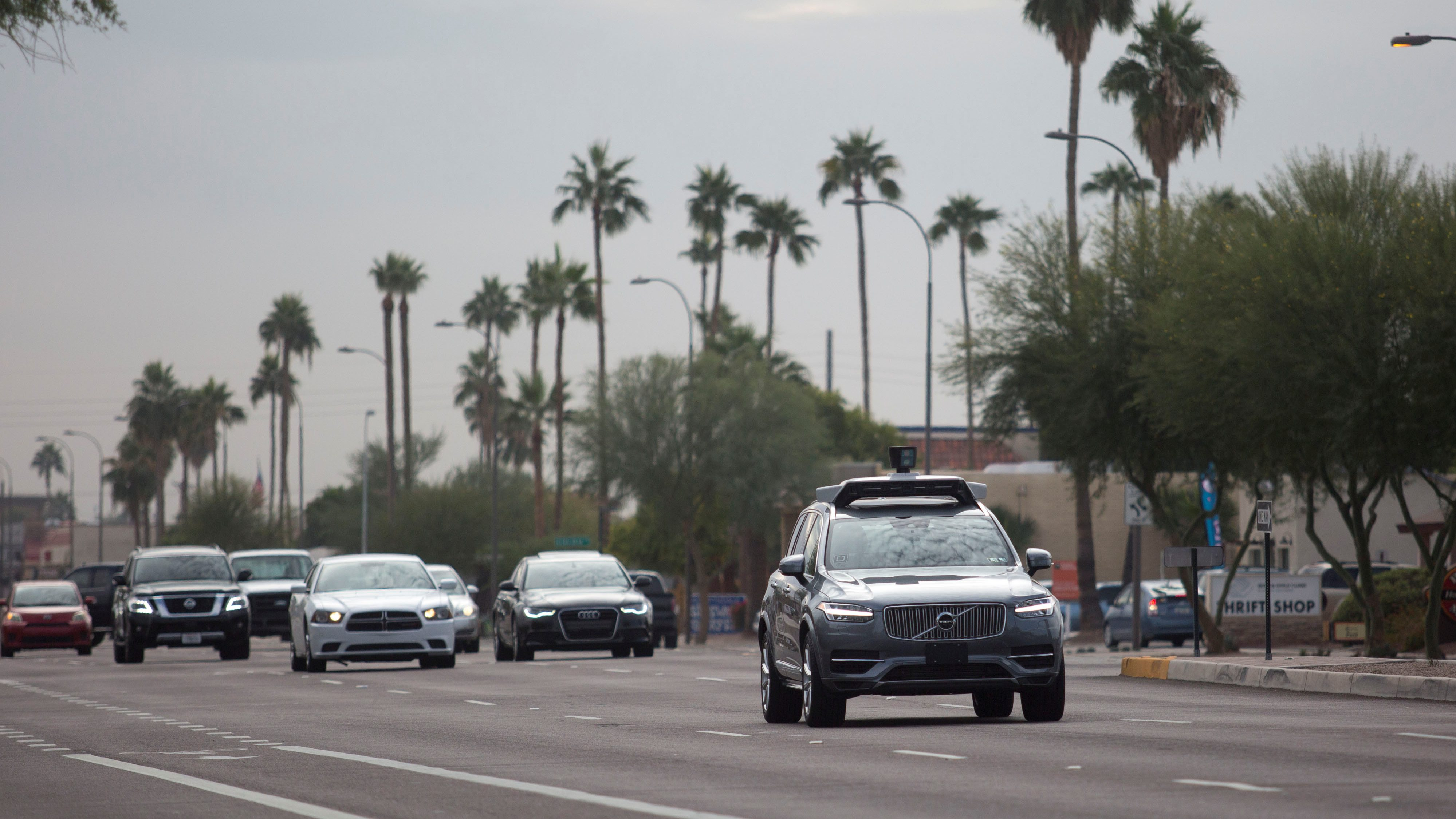 A self driving Volvo vehicle, purchased by Uber, moves along the streets of Scottsdale, Arizona, U.S., December 1, 2017.  Photo taken on December 1, 2017.  REUTERS/Natalie Behring - RC13FBC23080