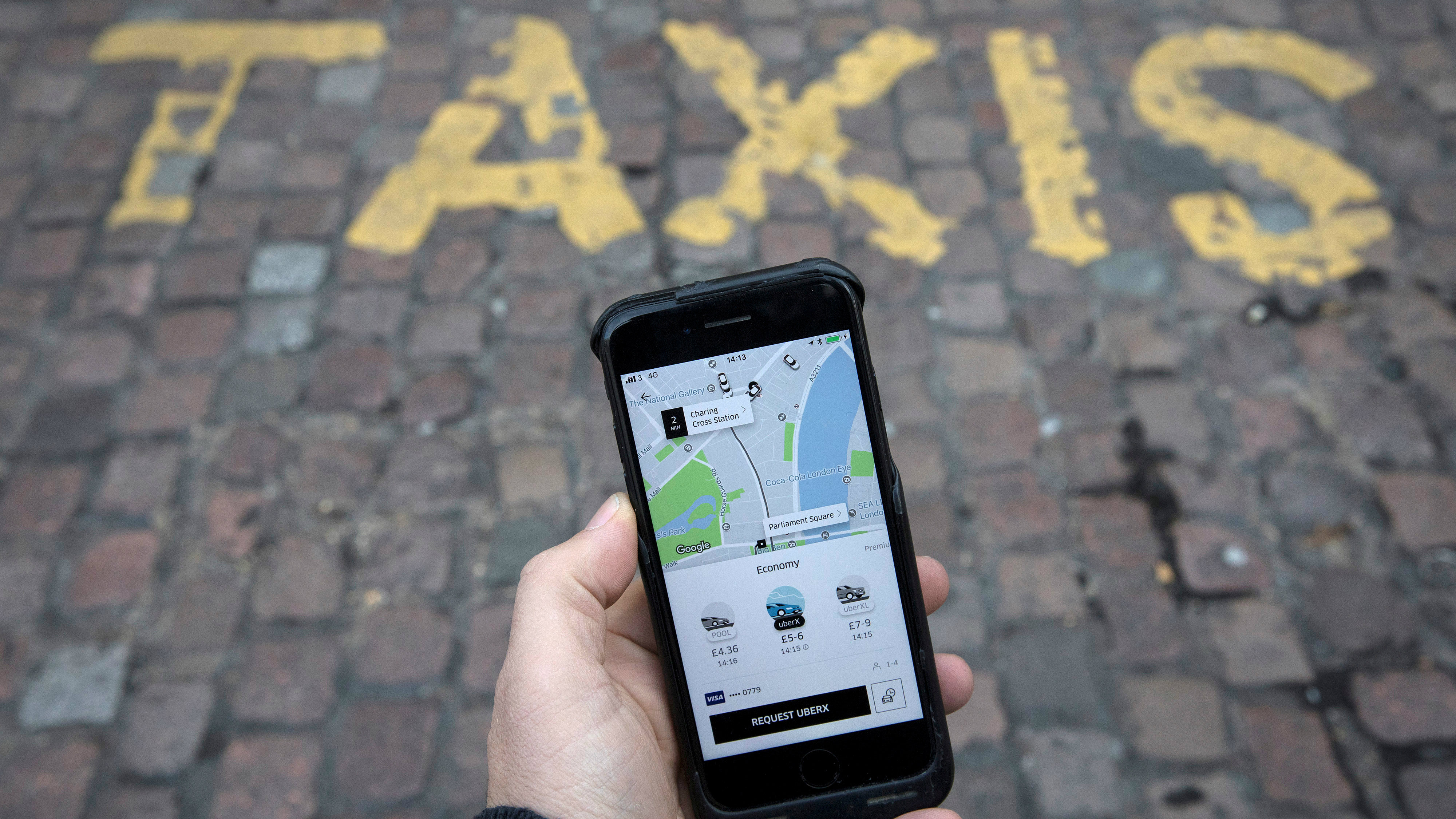 A photo illustration shows the Uber app on a mobile telephone, as it is held up for a posed photograph, in London, Britain November 10, 2017.