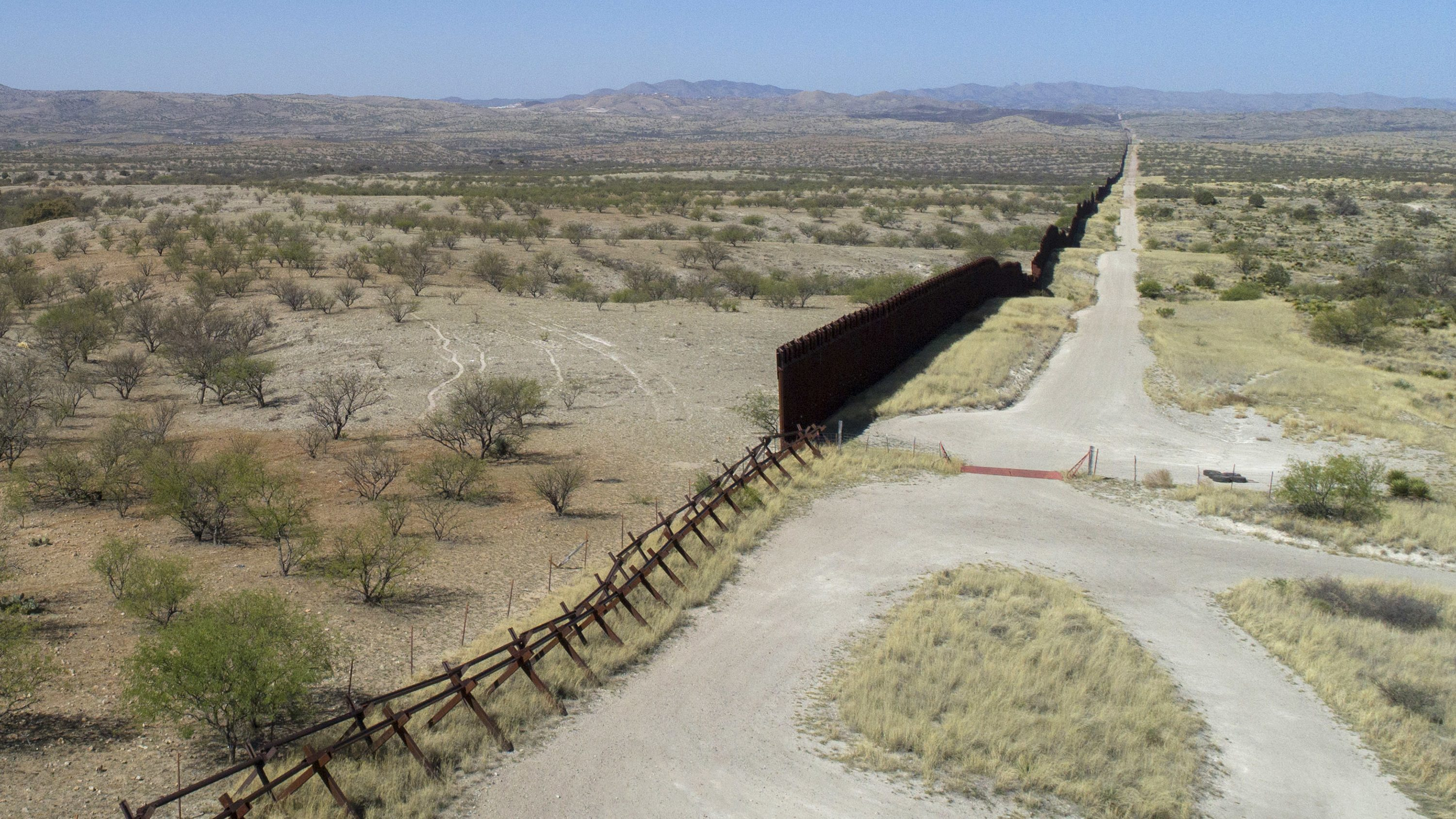 A drone view of the US-Mexico border fence outside Nogales, Arizona